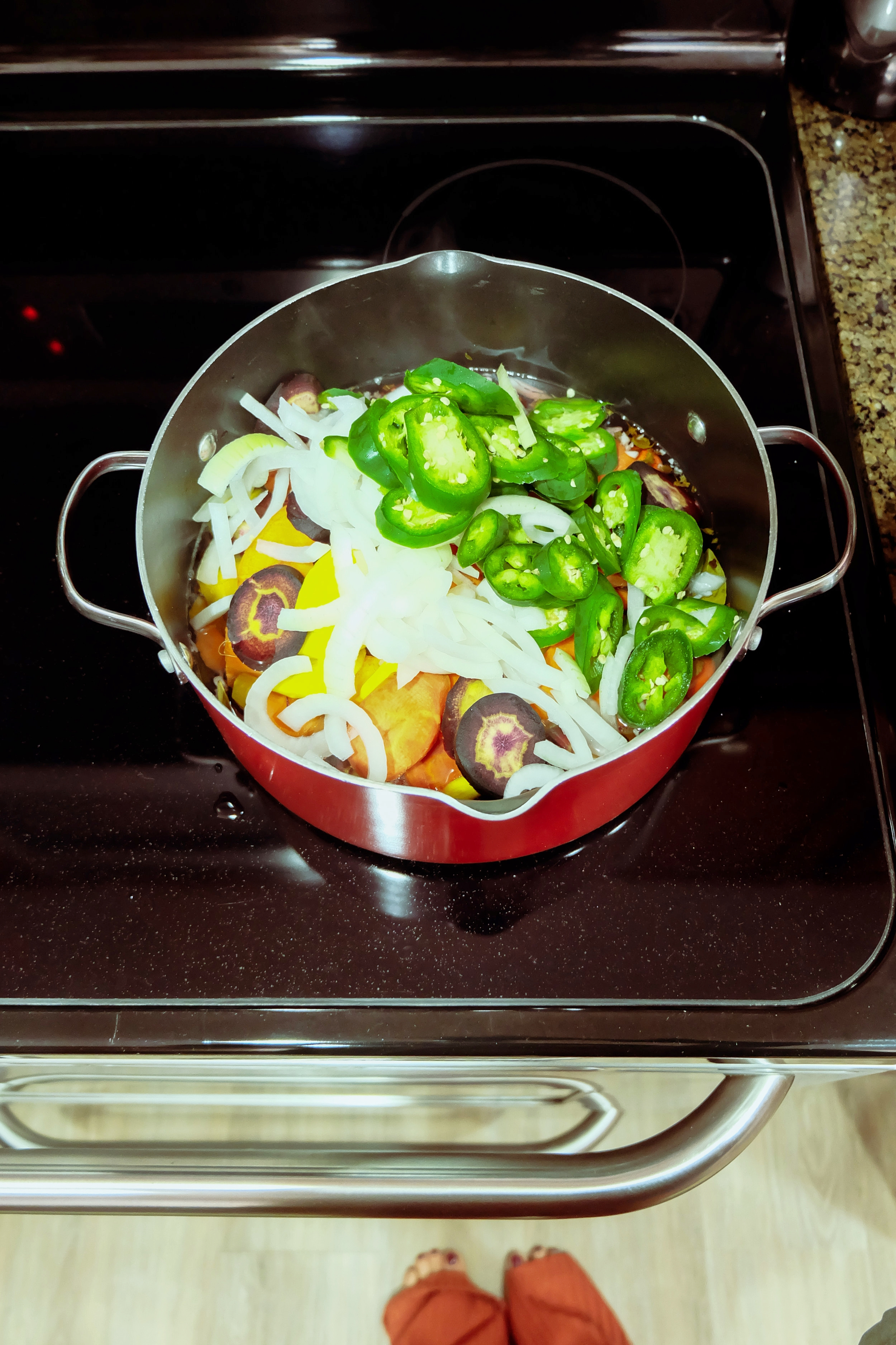 5. - Bring to a boil and add the carrots, onion and jalapeños. Lower heat to medium-low and cook for 15 minutes, uncovered.