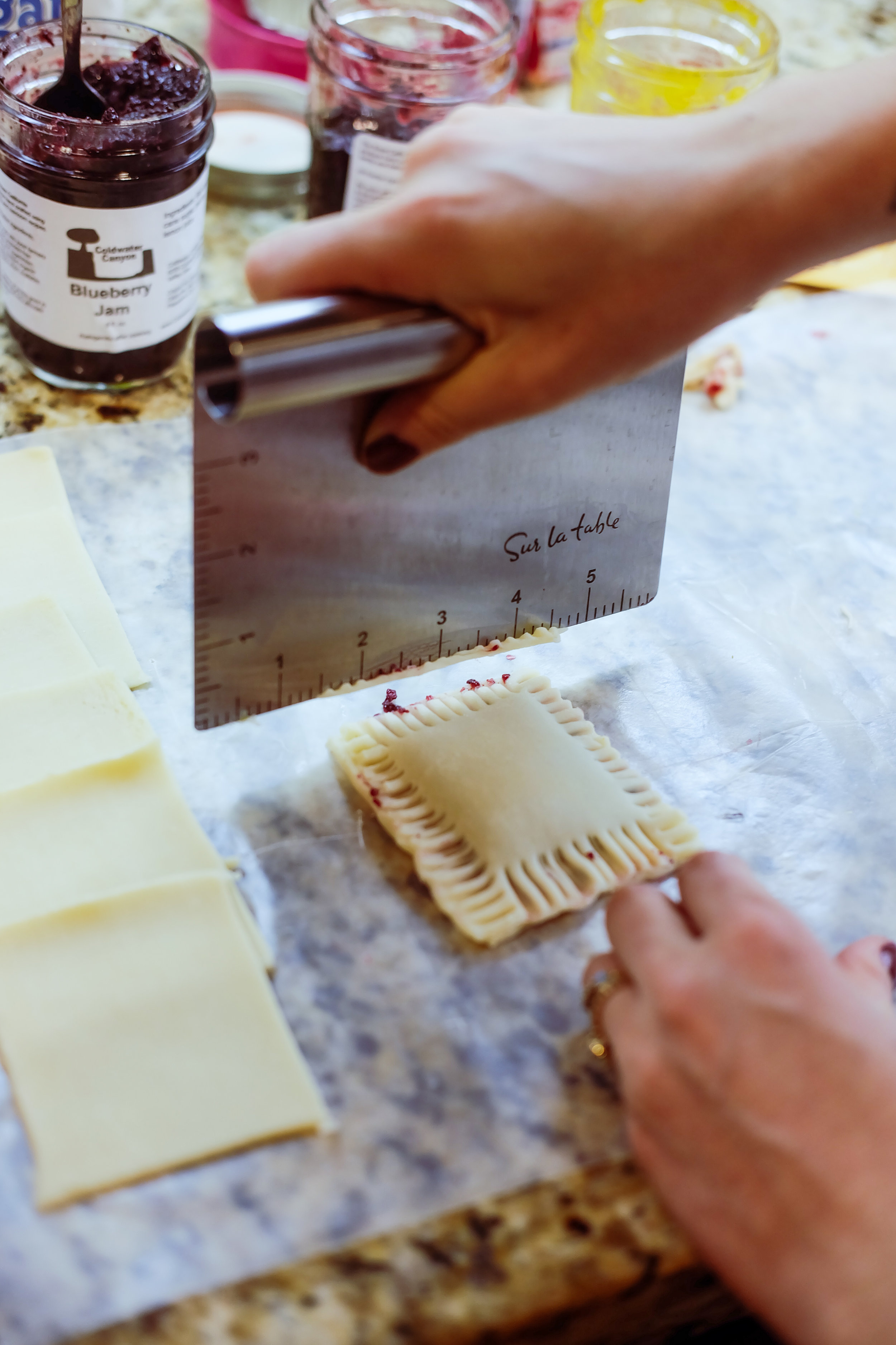 If you have a straight edge or scraper, use it to cut away the messy edges from the forked edges. This helps to seal up the sides too!