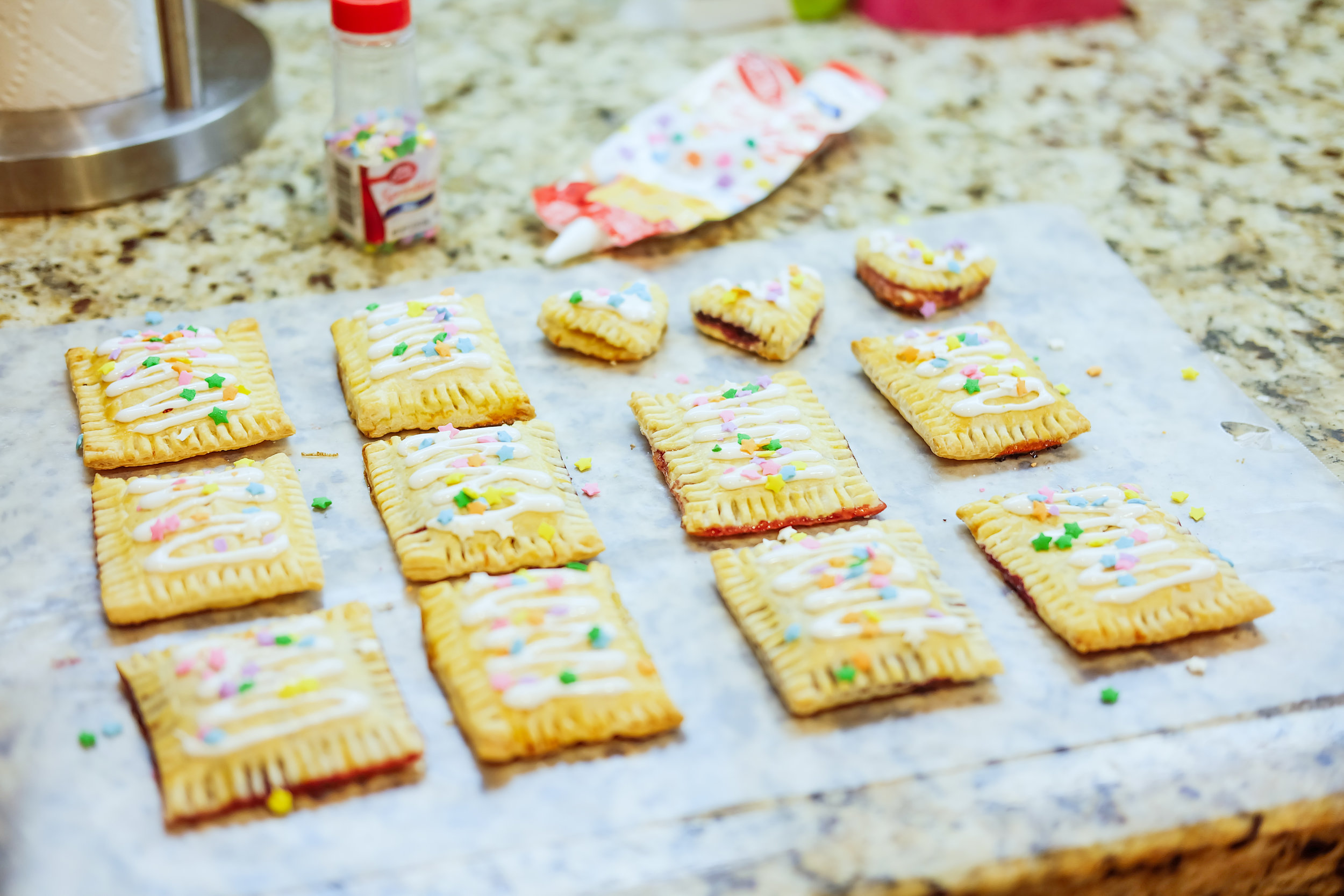 Once they're completely cooled, drizzle a frosting or icing of your choice over the top, and sprinkle some fun things on the drizzle!