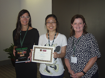 Qingin Hu (center) receives the Cargill Rapid Detection Poster Award. With her are Patricia Osborn (left) of Elsevier and Peggy Cook (right) of Cargill.