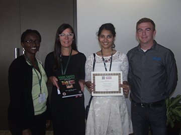 Supriya Thote (third from left) receives the Safe Foods Intervention Post-Harvest Poster Award. She also received the Michael G. Johnson Graduate Endowed Scholarship for Excellence in Food Microbiology Research, Teaching and Peer Mentoring (second place). With her are (from left) Beatrice Mangi of Safe Foods Corp., Patricia Osborn of Elsevier and Lawson Hembree of Safe Foods Corp.