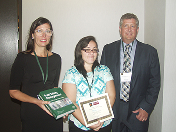 Mary Muckey (center) receives the 3-D Corporate Solutions Pet Food and Animal Feed Safety Poster Award (Third Place). With her are Patricia Osborn (left) of Elsevier and Hank Cotney (right) of 3-D Corporate Solutions.