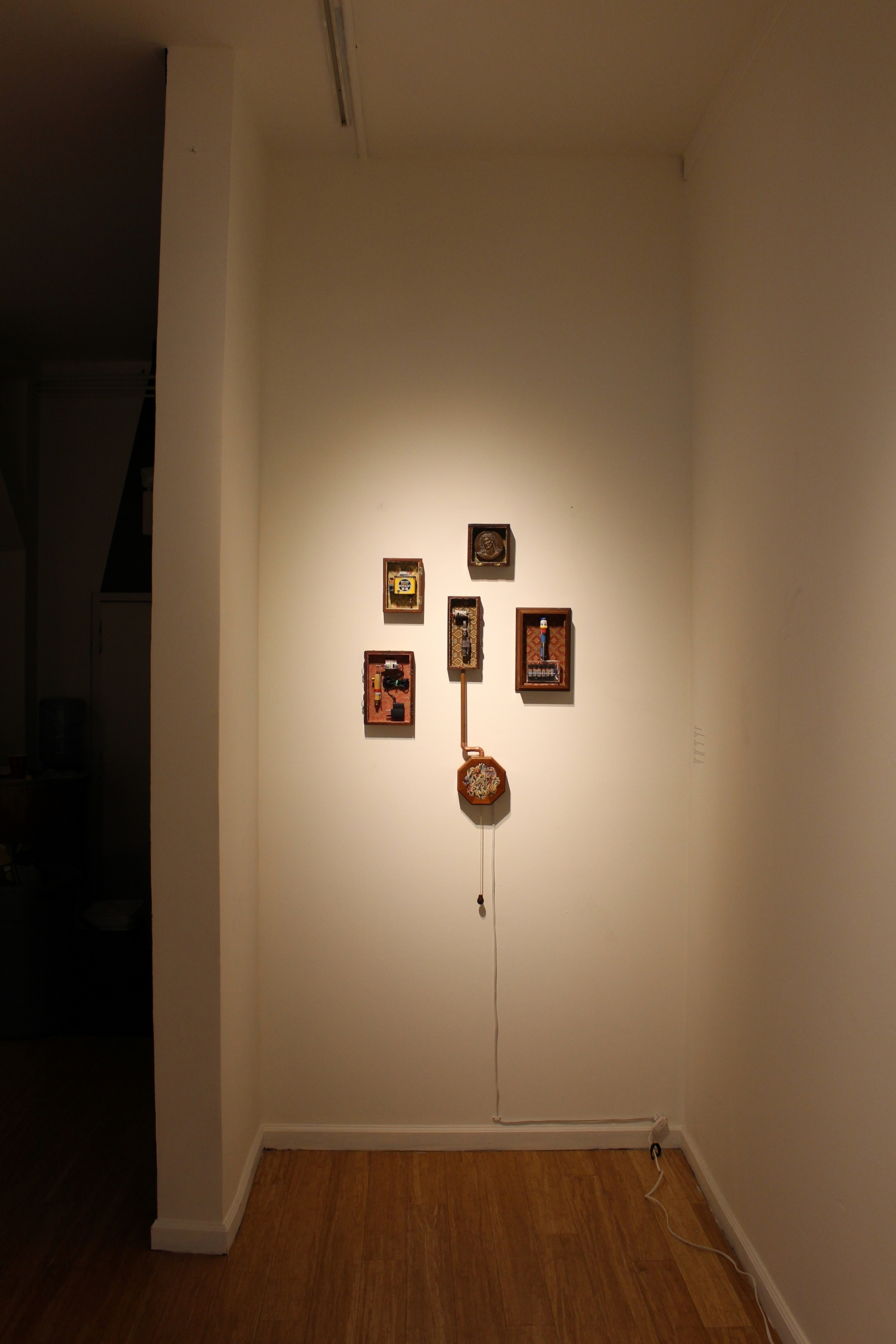Thesis installation at Gauntlet Gallery.  All machines are fully functional, including center machine with a hanging lamp switch to turn on/off.
