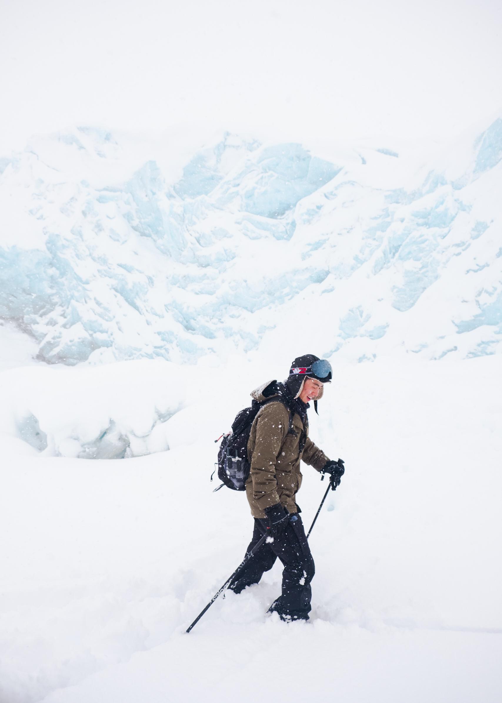 man cross country skiing in alaska
