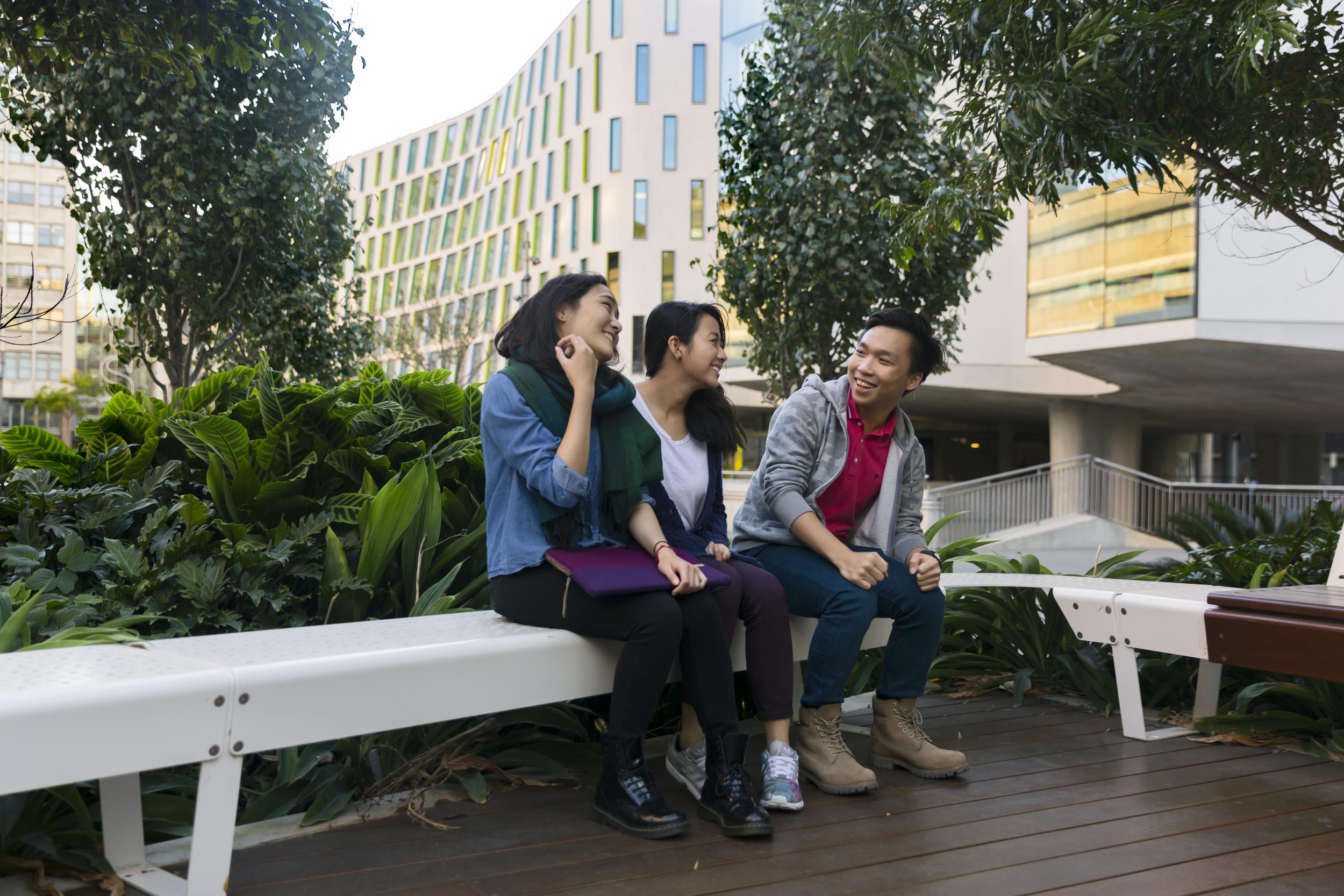 Friends sitting in alumni area.jpg