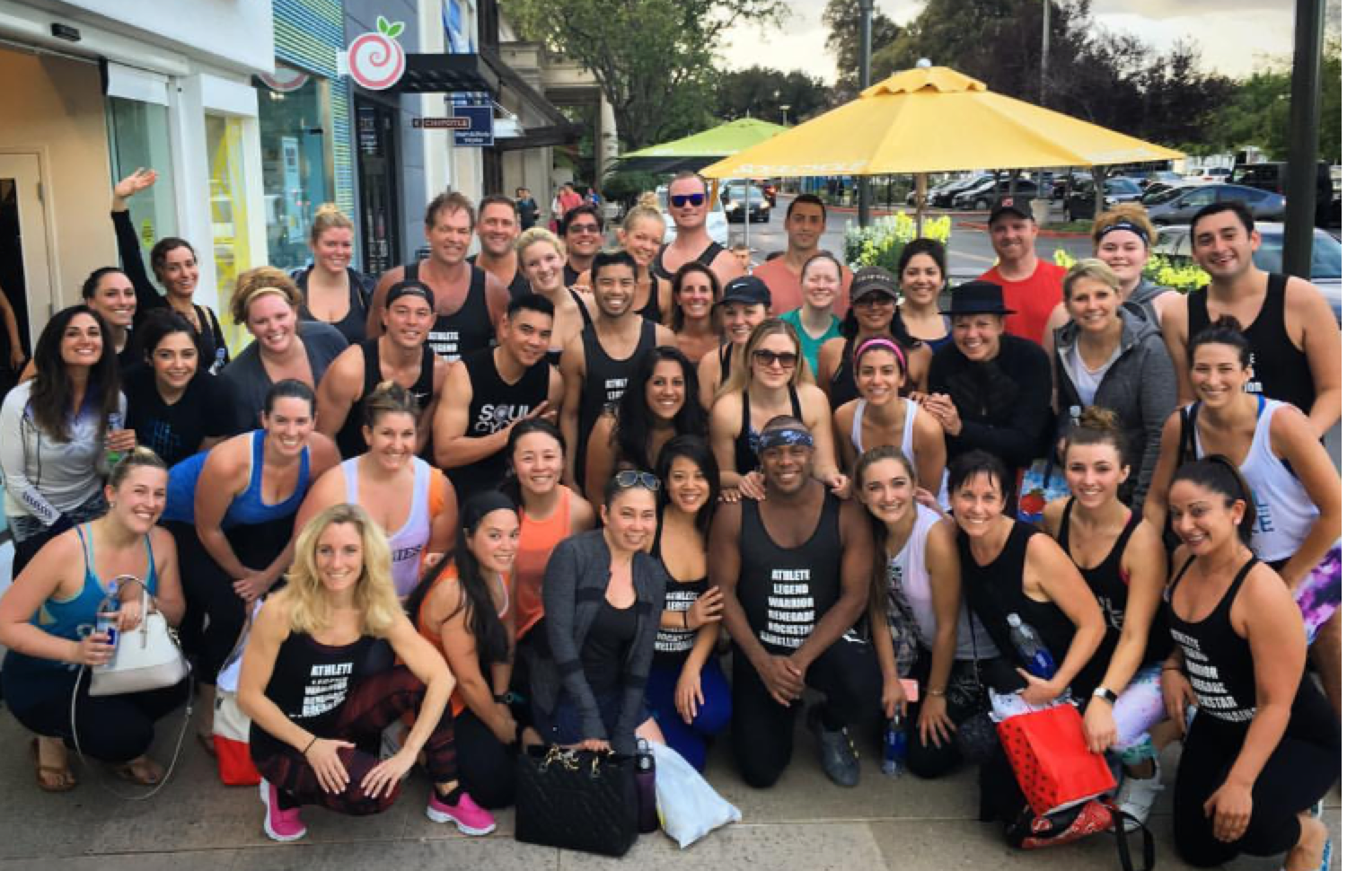 SoulCycle soulmates pictured with instructor Kamelle in front of the Stanford SoulCycle studio.
