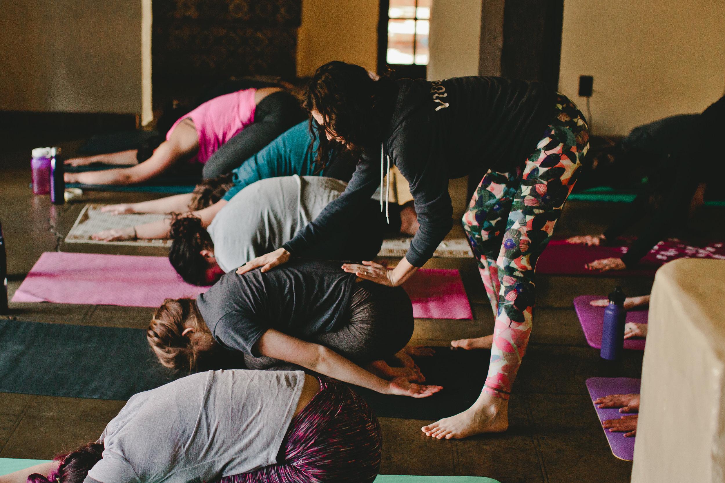 Misha Krepon representing  Vibe Yoga Studio  teaches vinyasa flow to kick-off the morning.