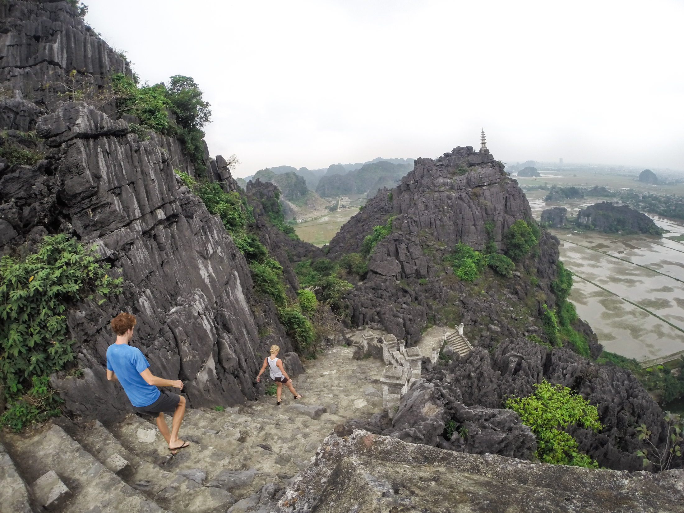 David and Kelsey Tilley on a hike in Vietnam near the Mua Caves.