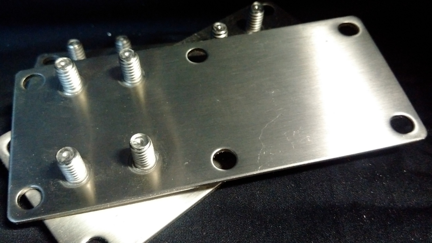 S.S. Top bracket adjustment plate