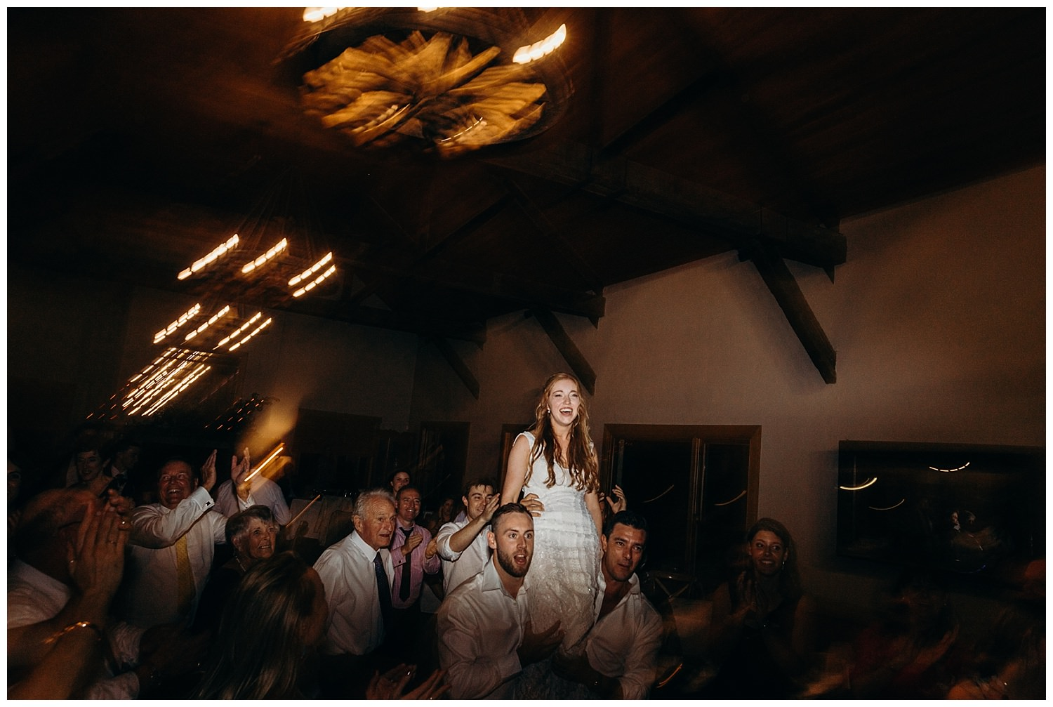 Bowral Southern Highlands Autumn Wedding - Bride lifted up at wedding reception