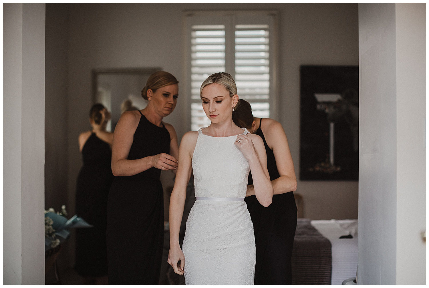 Bridesmaids help Sydney Bride into her Kristy Dress by Karen Willis Holmes