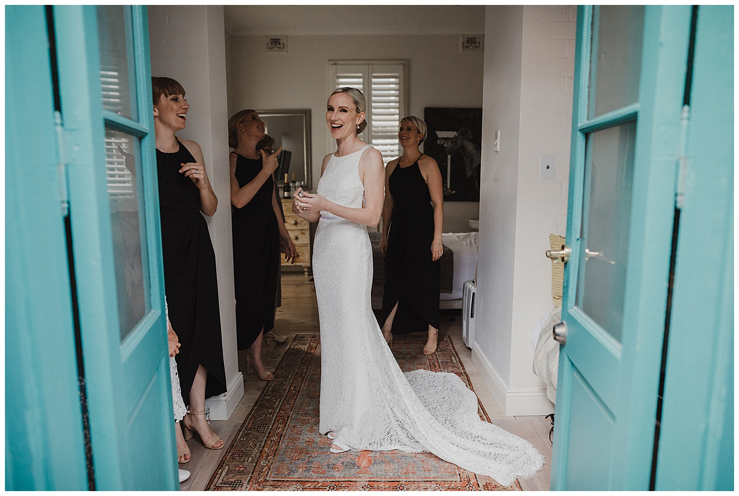 Bride laughs during a candid moment before her Sydney Wedding