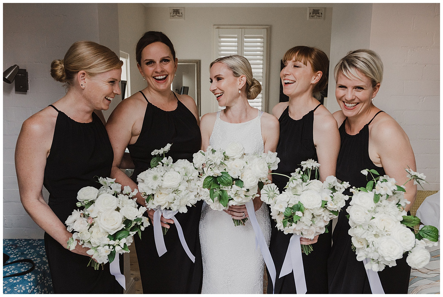 Sydney Bride share a laugh with her bridesmaids