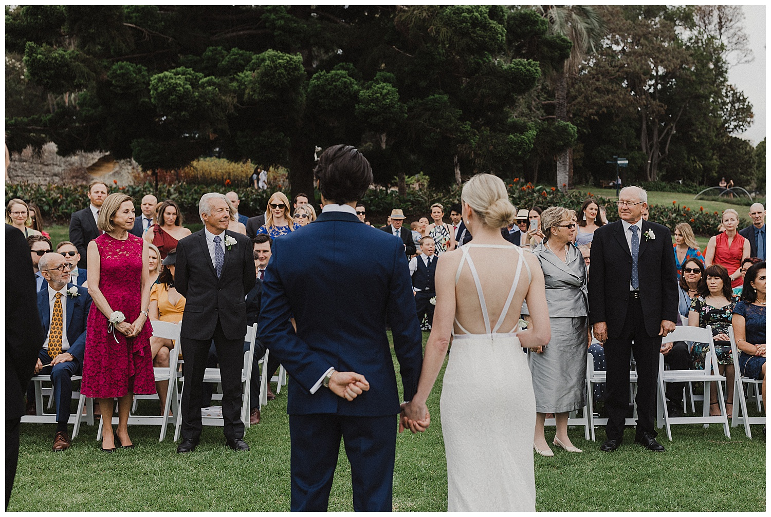 Bride and groom are given away by parents at this Sydney Wedding Ceremony