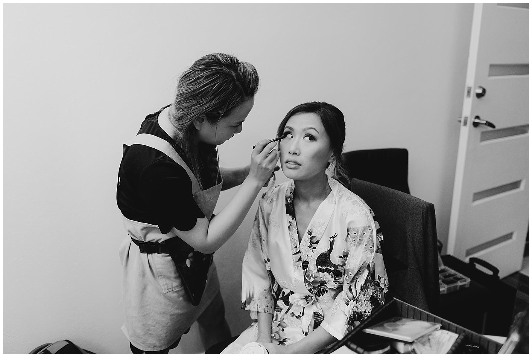 Black and white shot of Bride getting makeup done
