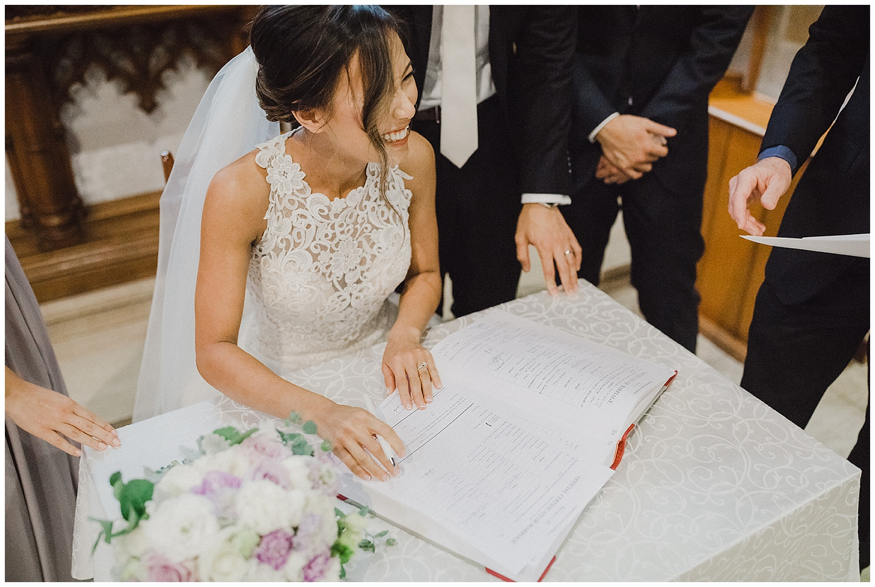 Bride and Groom signing their marriage certificate