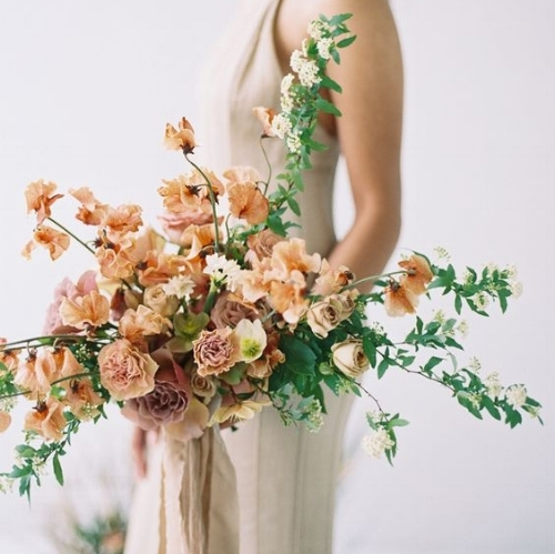 Peach bridal bouquet by Ambedo Floral.