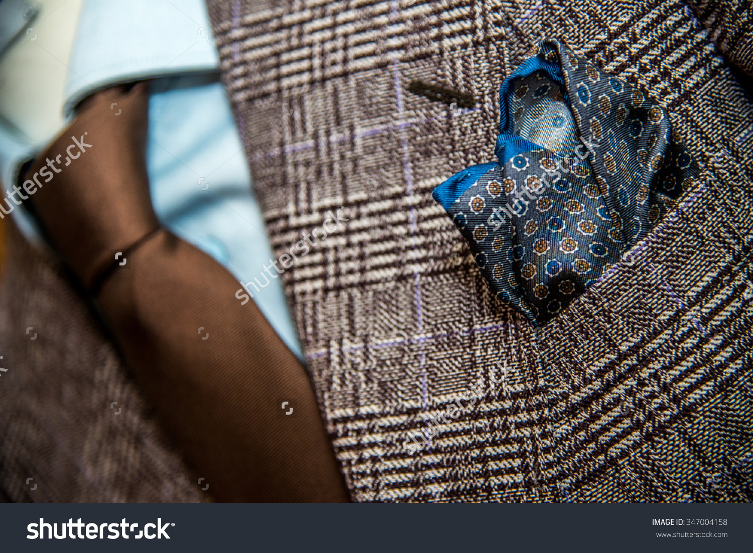 stock-photo-beautiful-blue-suits-with-tie-tie-clip-and-handkerchief-on-a-mannequin-391300729.jpg