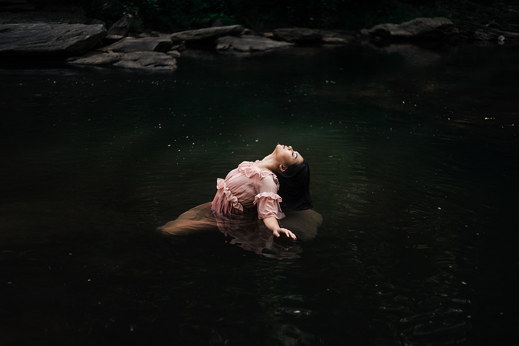 Listening to the lyrics, I couldn't get the image of a woman in a flowy dress floating in water out of my mind. -