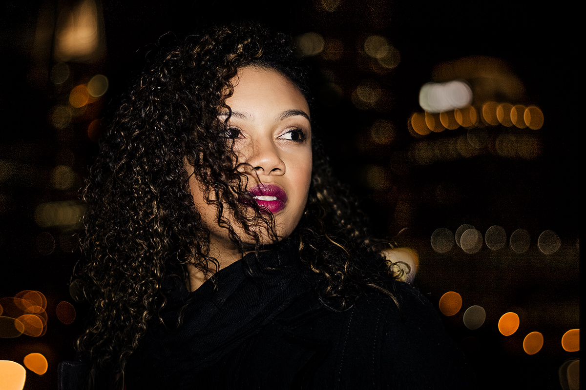 young-black-woman-with-curly-hair-in-downtown-Atlanta-night-photography-by-photographer-Chanel-French