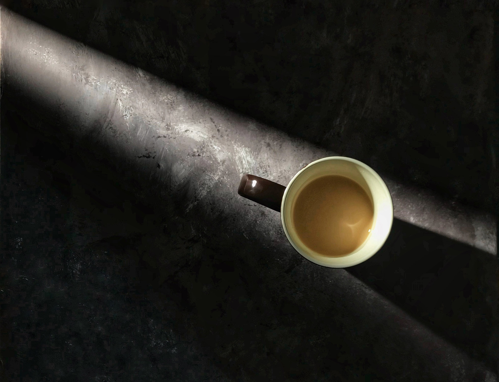 Cup of coffee in morning light.