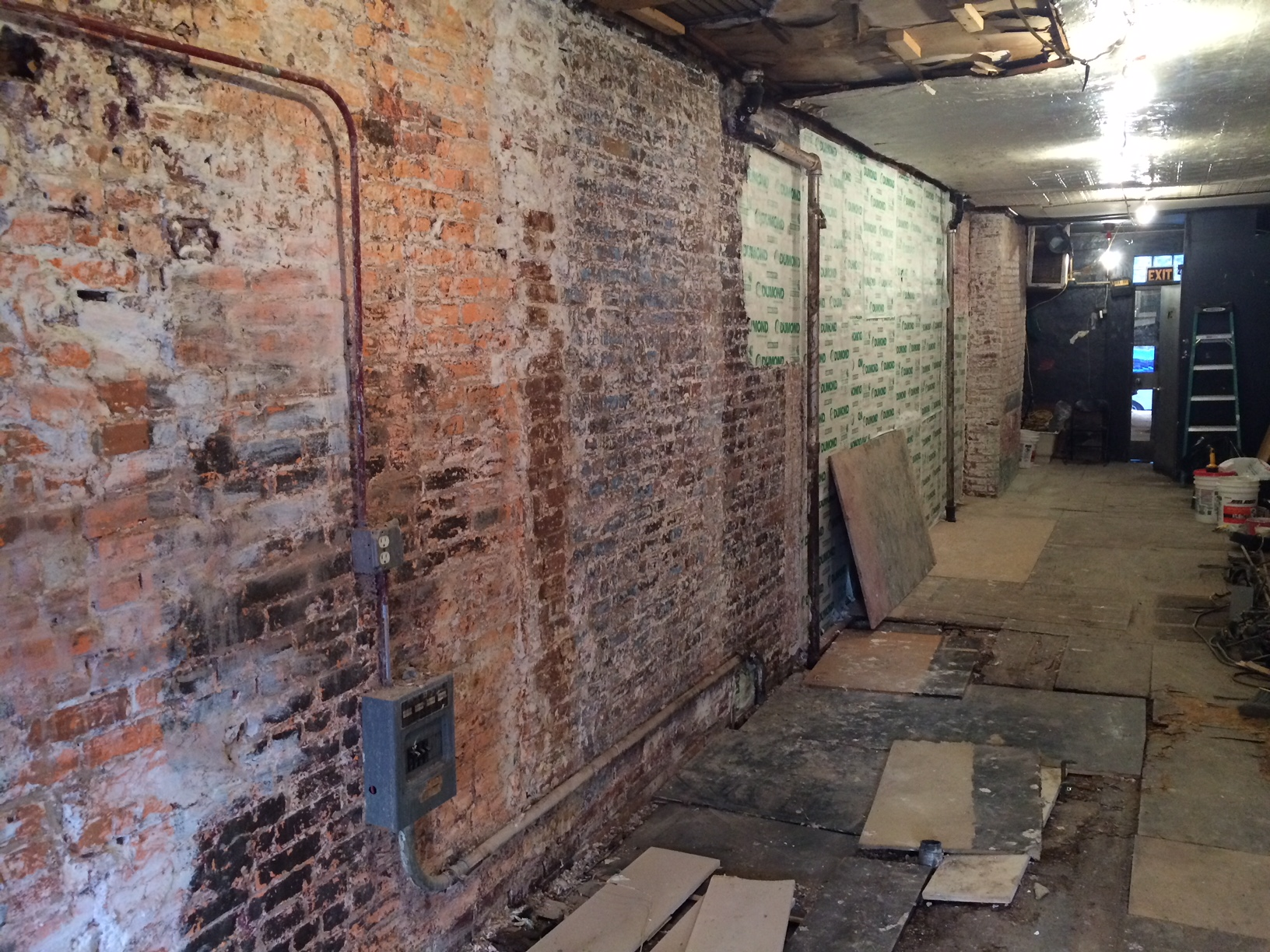 The left/south wall post demolition. Check out that floor!