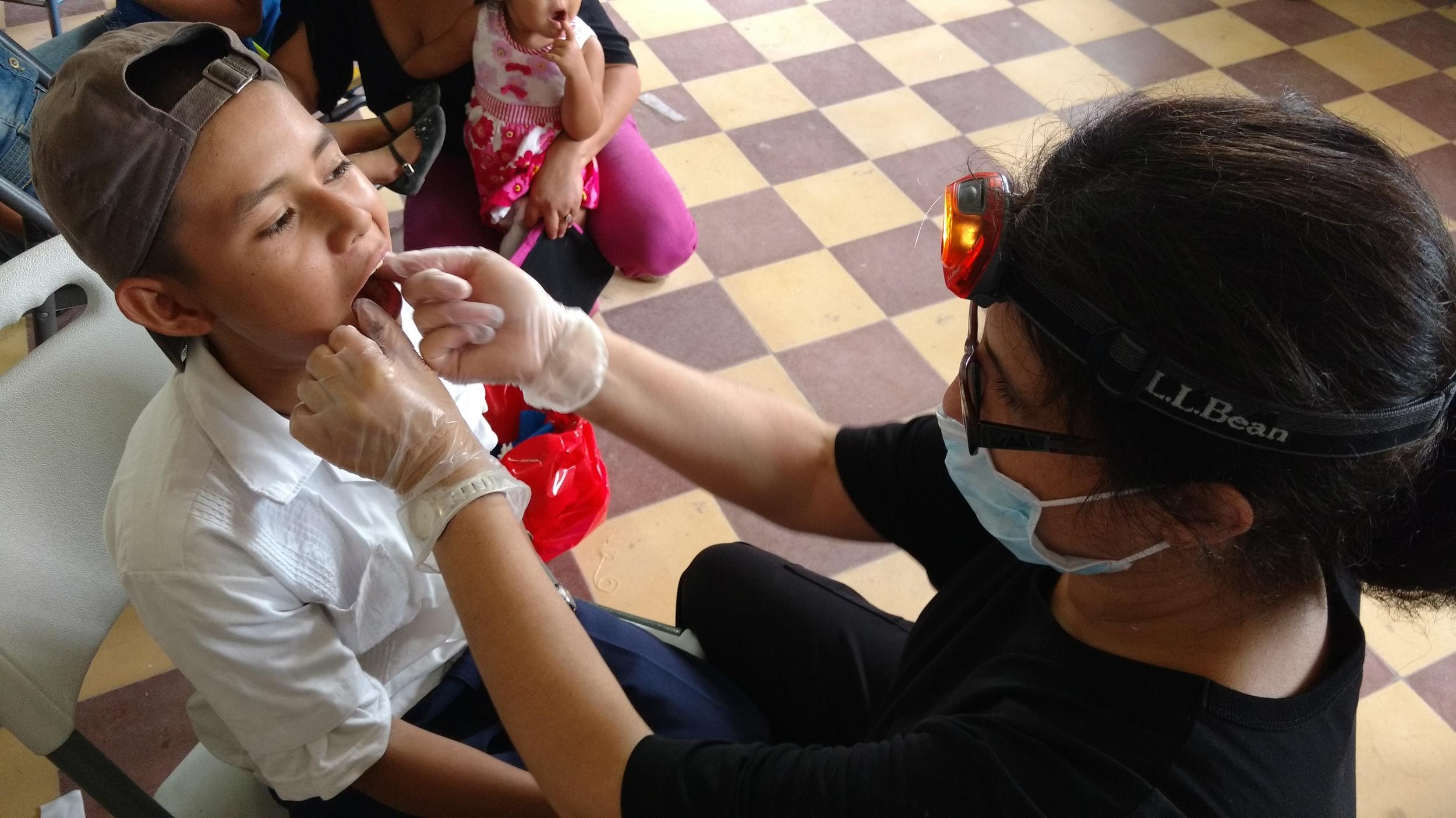 Dr. Tinka Kornerup applying fluroride to this young man's teeth.