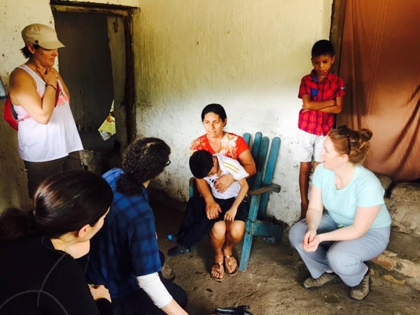 Visiting a family at home to diagnose a child and provide information on his needs and how to maximize his potential.