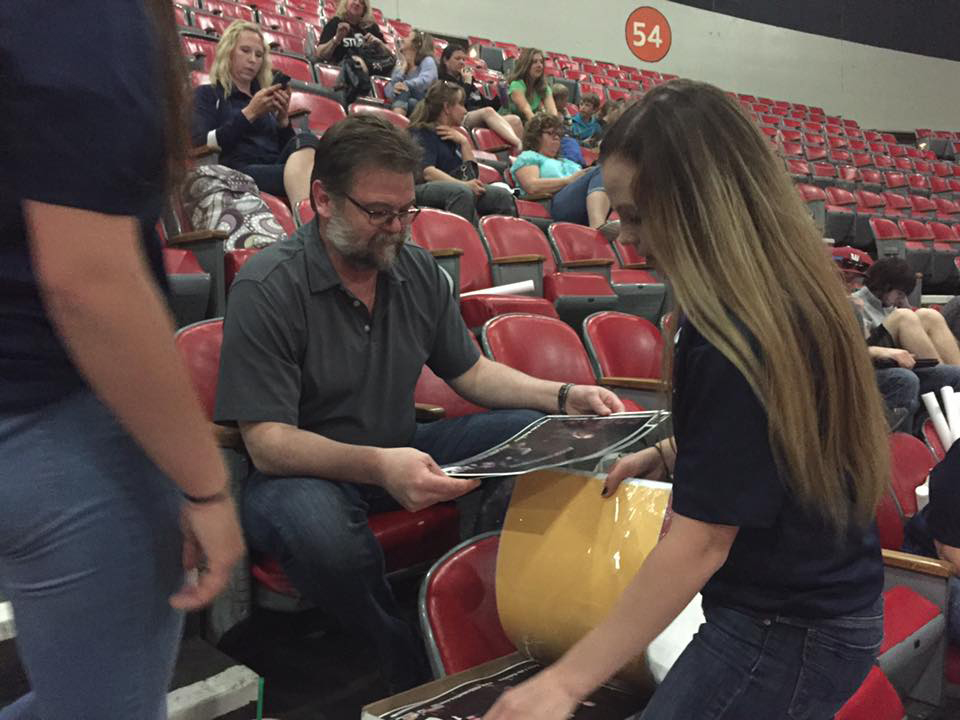 Mark Twietmeyer checking out posters to encourage more girls to become involved with robotics and engineering.
