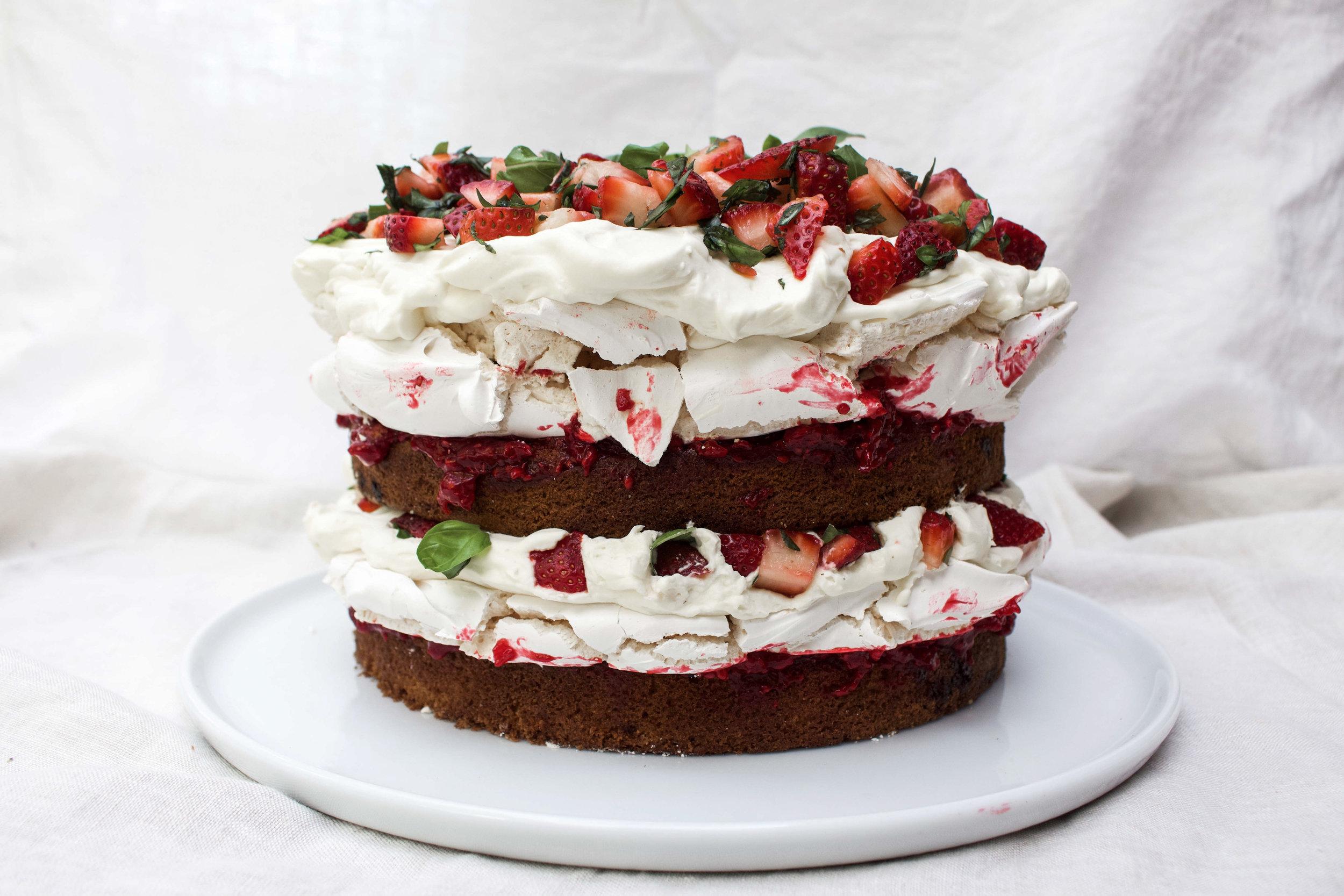 < victoria sponge w/ meringue layers, cream, strawberries & basil >