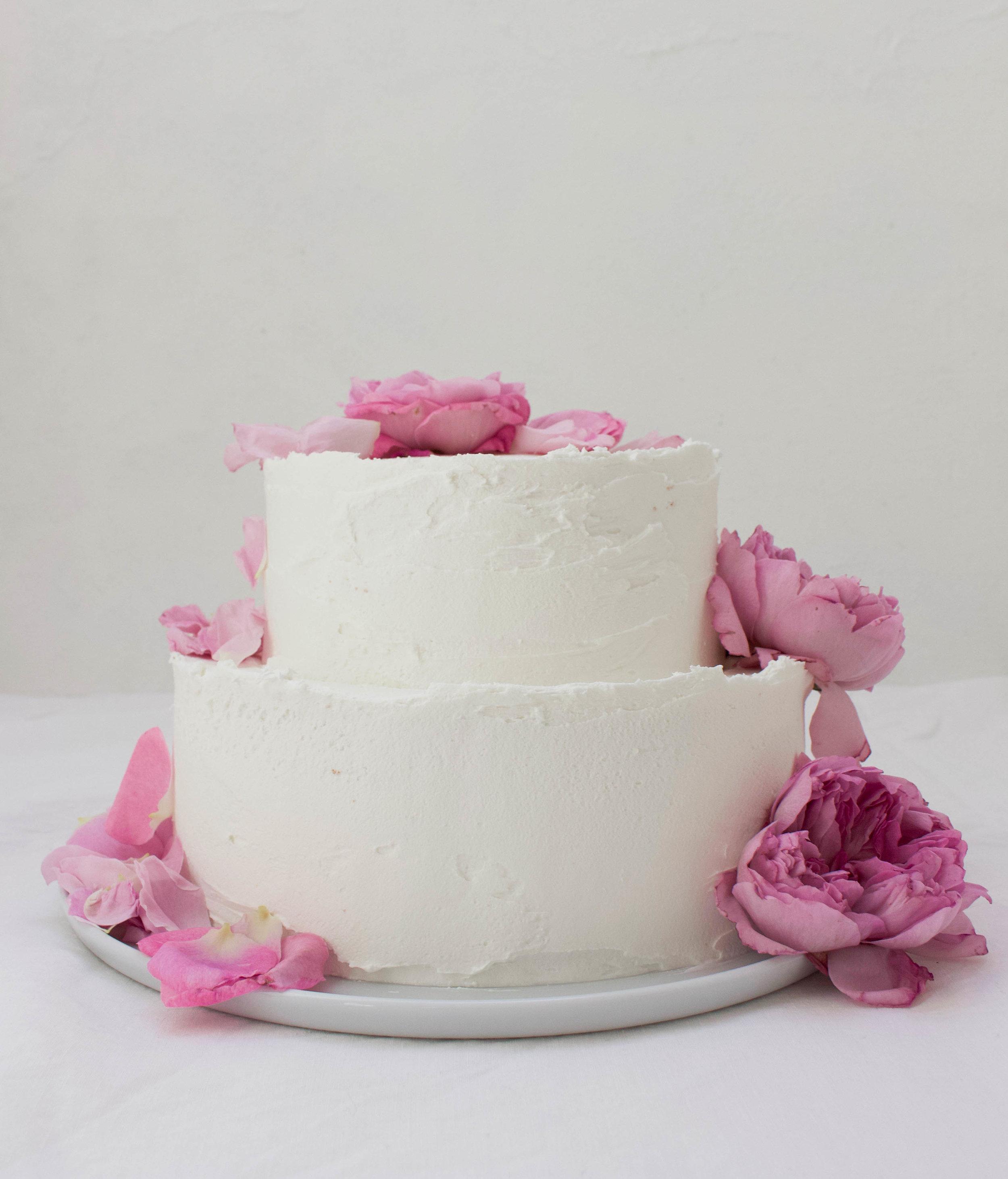 < buttermilk sponge w/ summer berry filling & vanilla frosting  wedding cake >