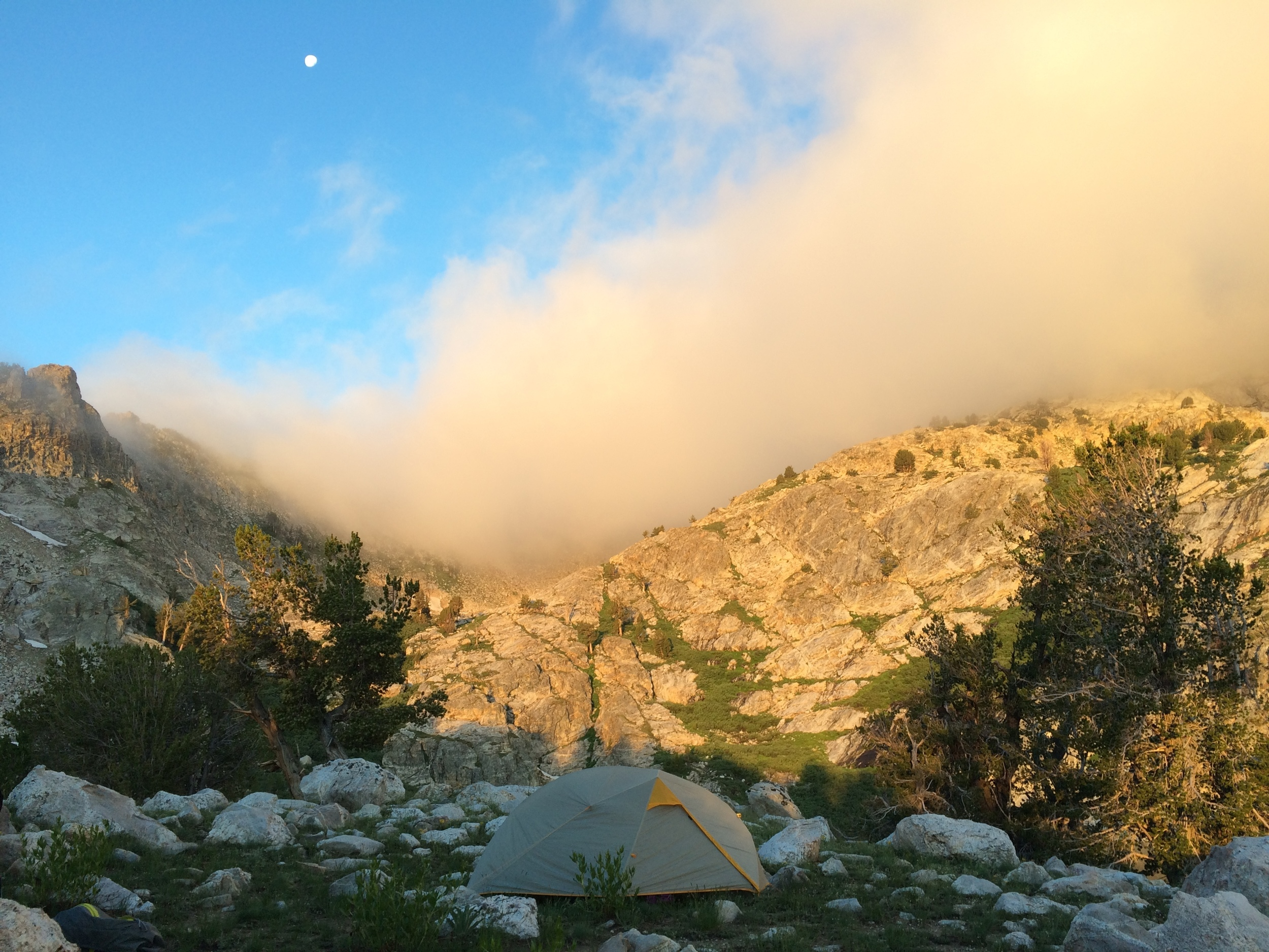 A setting moon framed by rising fog above our Overland Lk camp