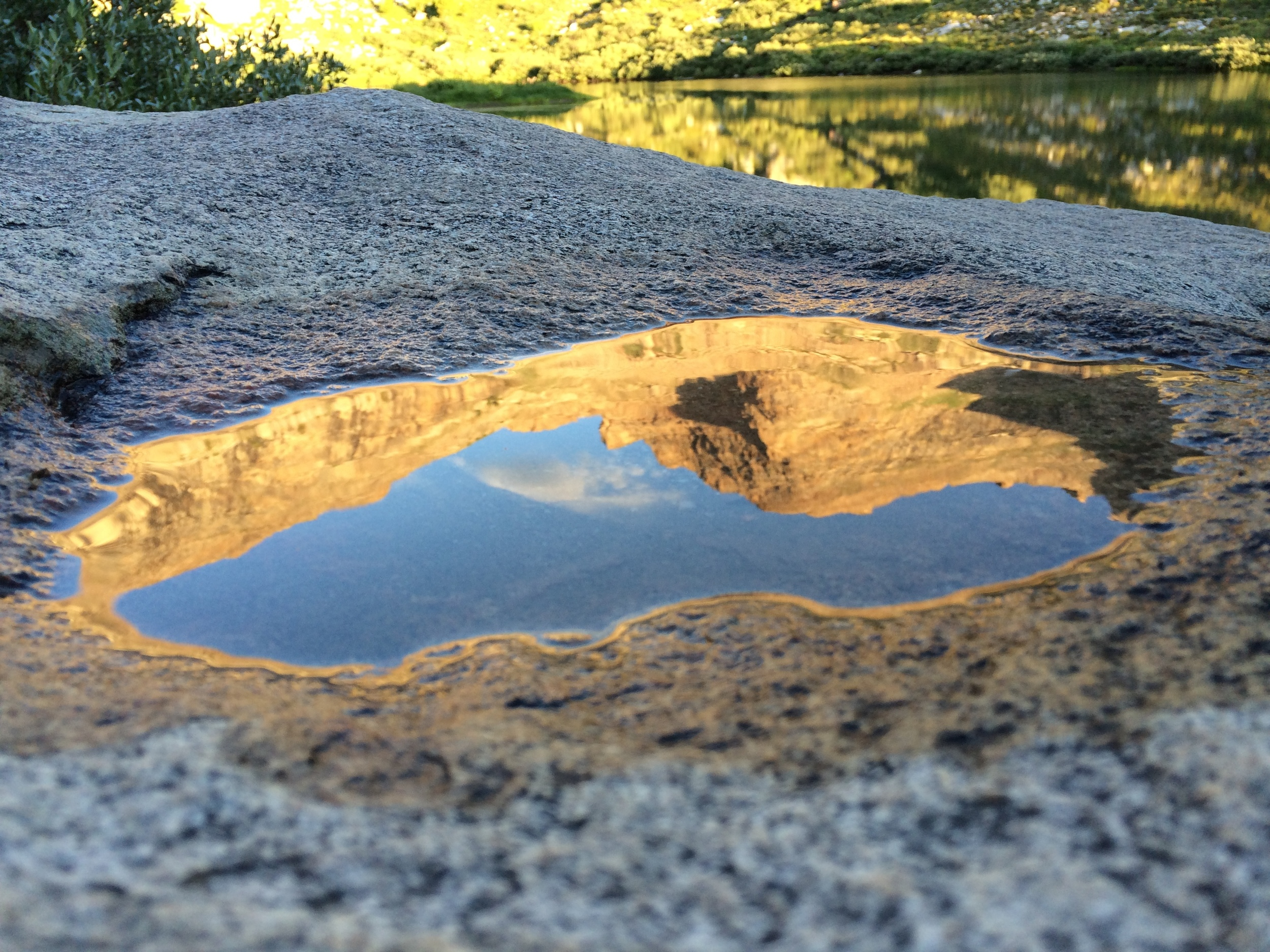 Puddlegram in a boulder near Island Lake, with a reflection of the pass to Thomas Canyon
