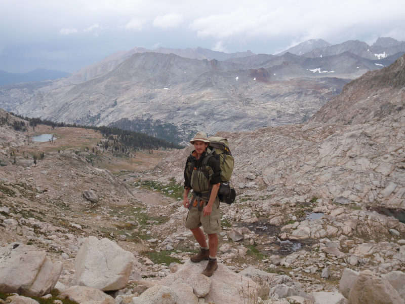 Mike on the south side of Colby Pass, view of small tarn below Milestone Bowl to the left