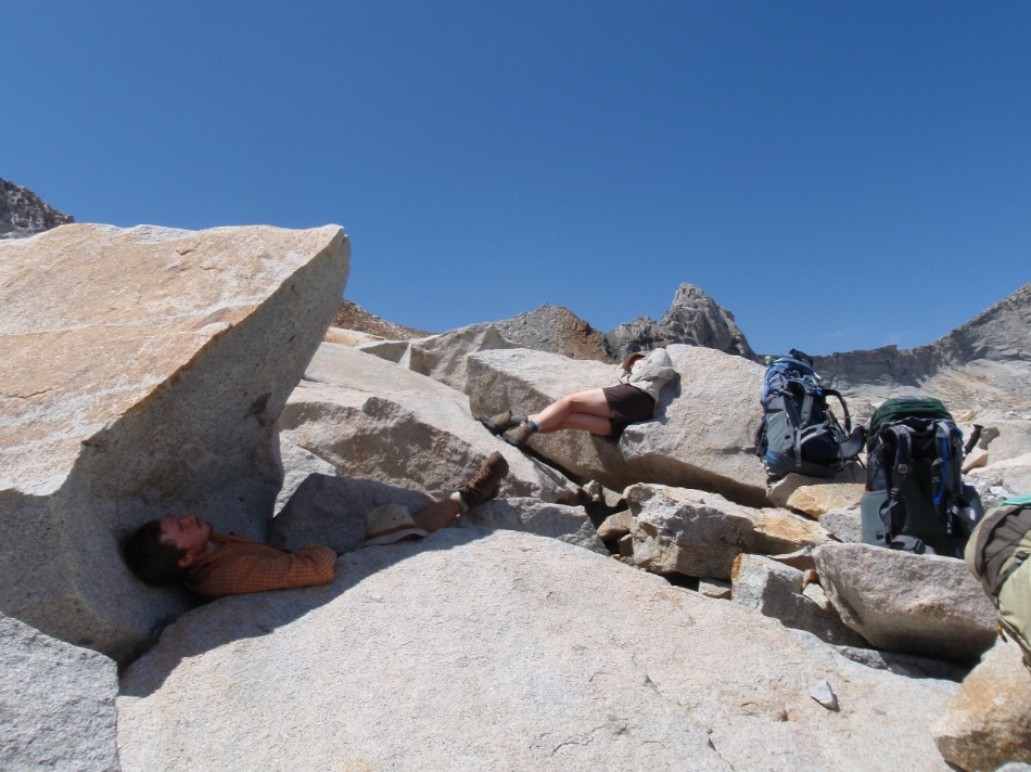 Mike (shade) and Cheri (sun) lounging on boulders at Elizabeth Pass after lunch