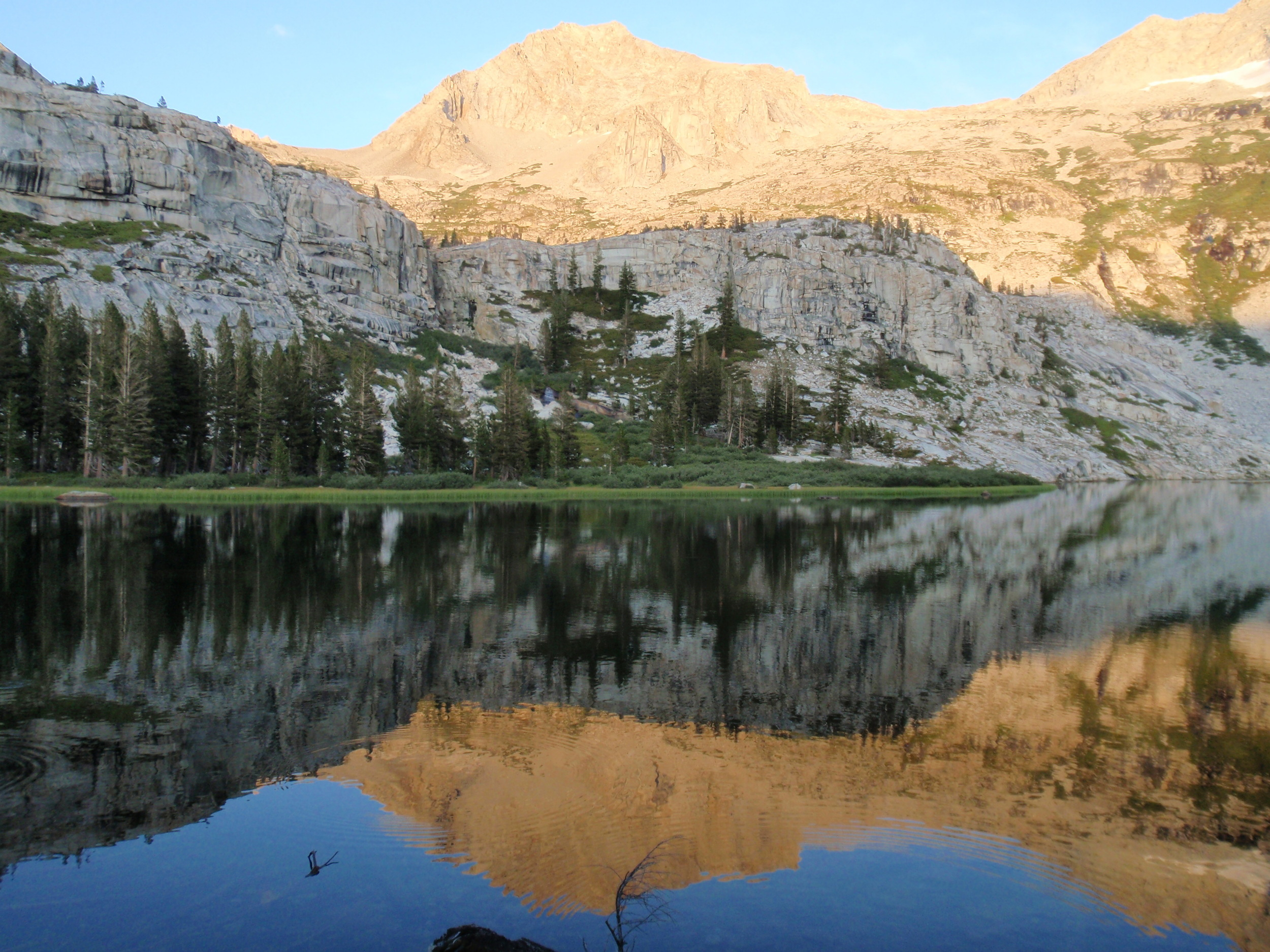 Lion Rock reflected in Tamarack Lake, evening golden hour