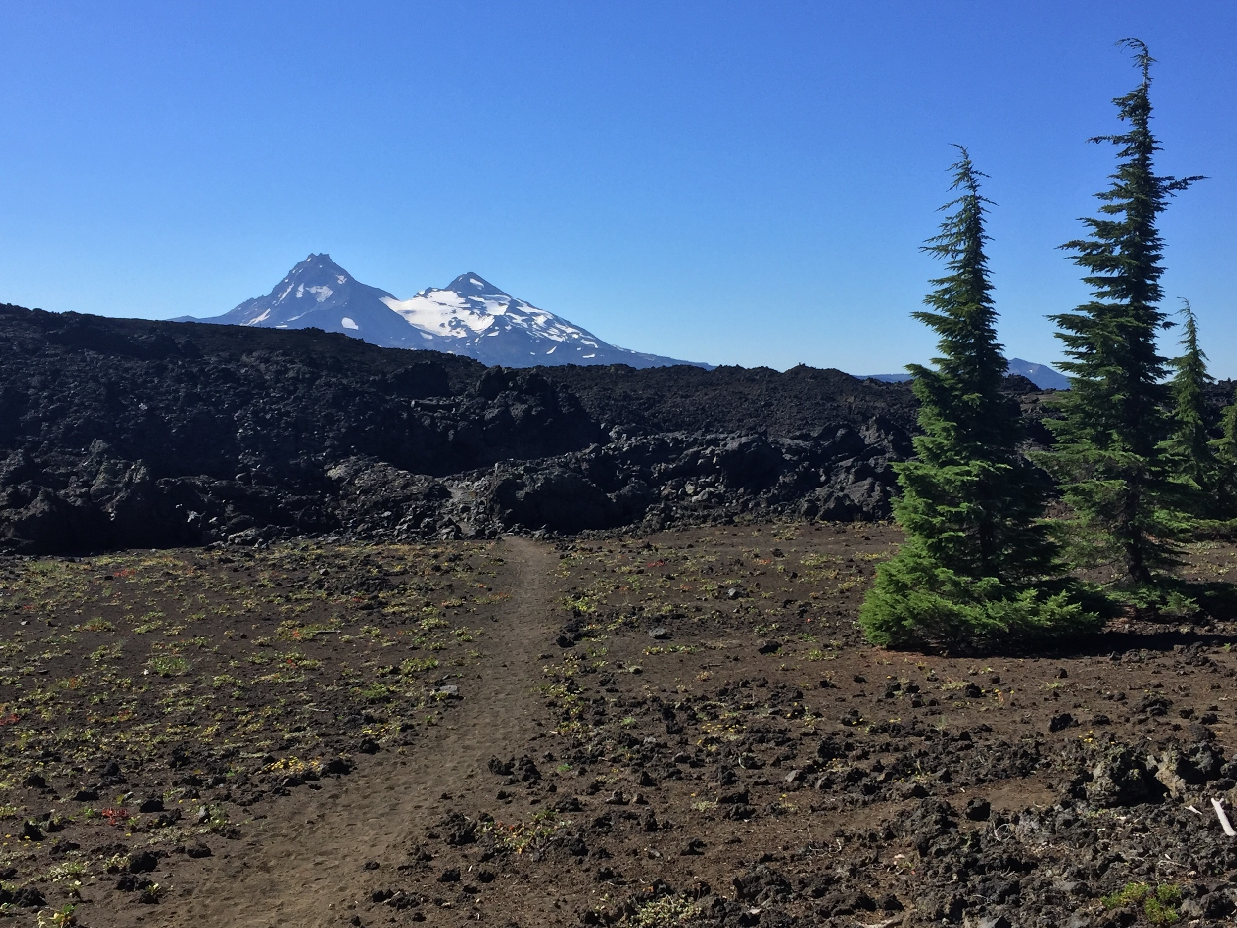Middle & North Sister across the edge of the lava fields