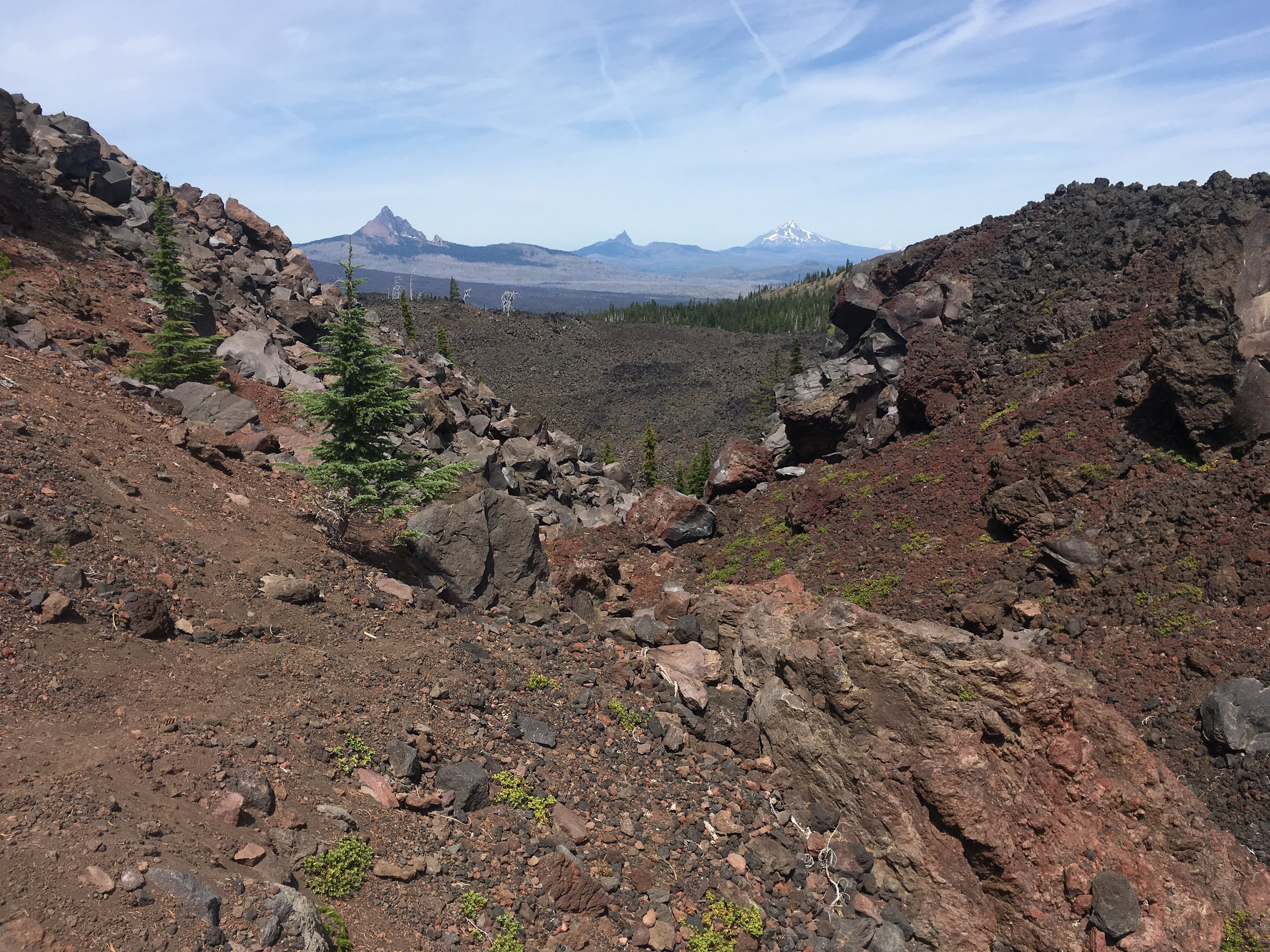 From left to right Mt. Washington, Three Fingered Jack, and Mt. Jefferson (with Mt. Hood faintly visible to his R shoulder)