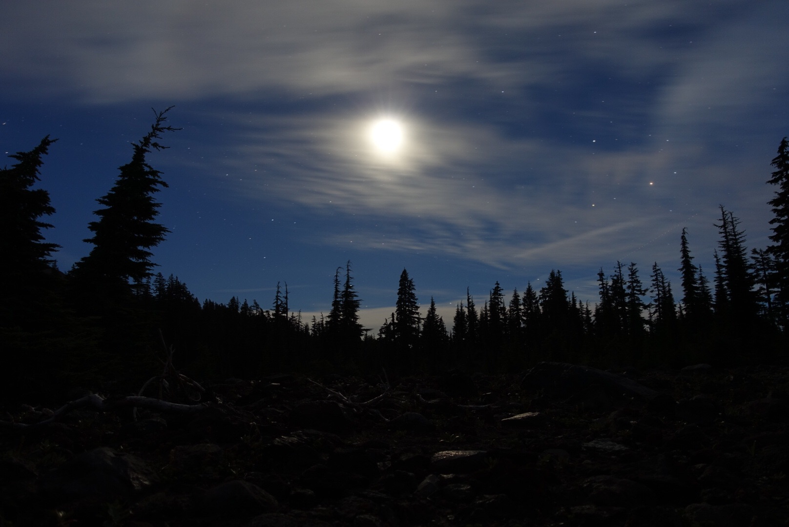 Nearly full moon illuminating clouds with Scorpio, Mars and Saturn