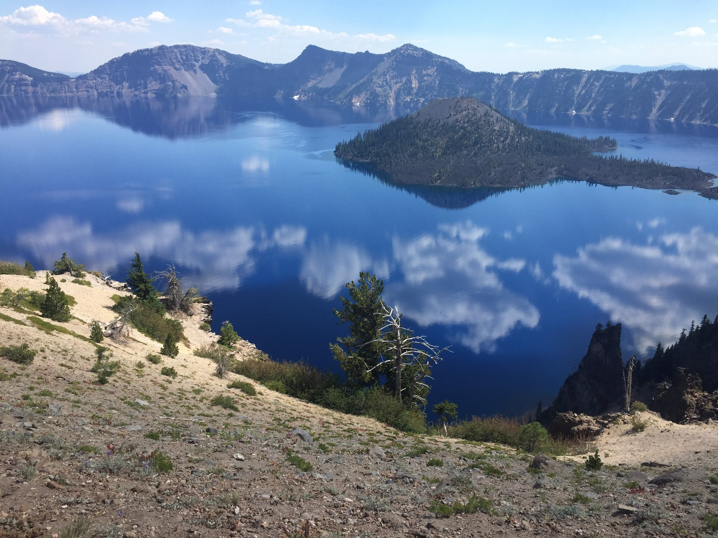 The sky may be hazy, but the waters of Crater Lake are intensely blue