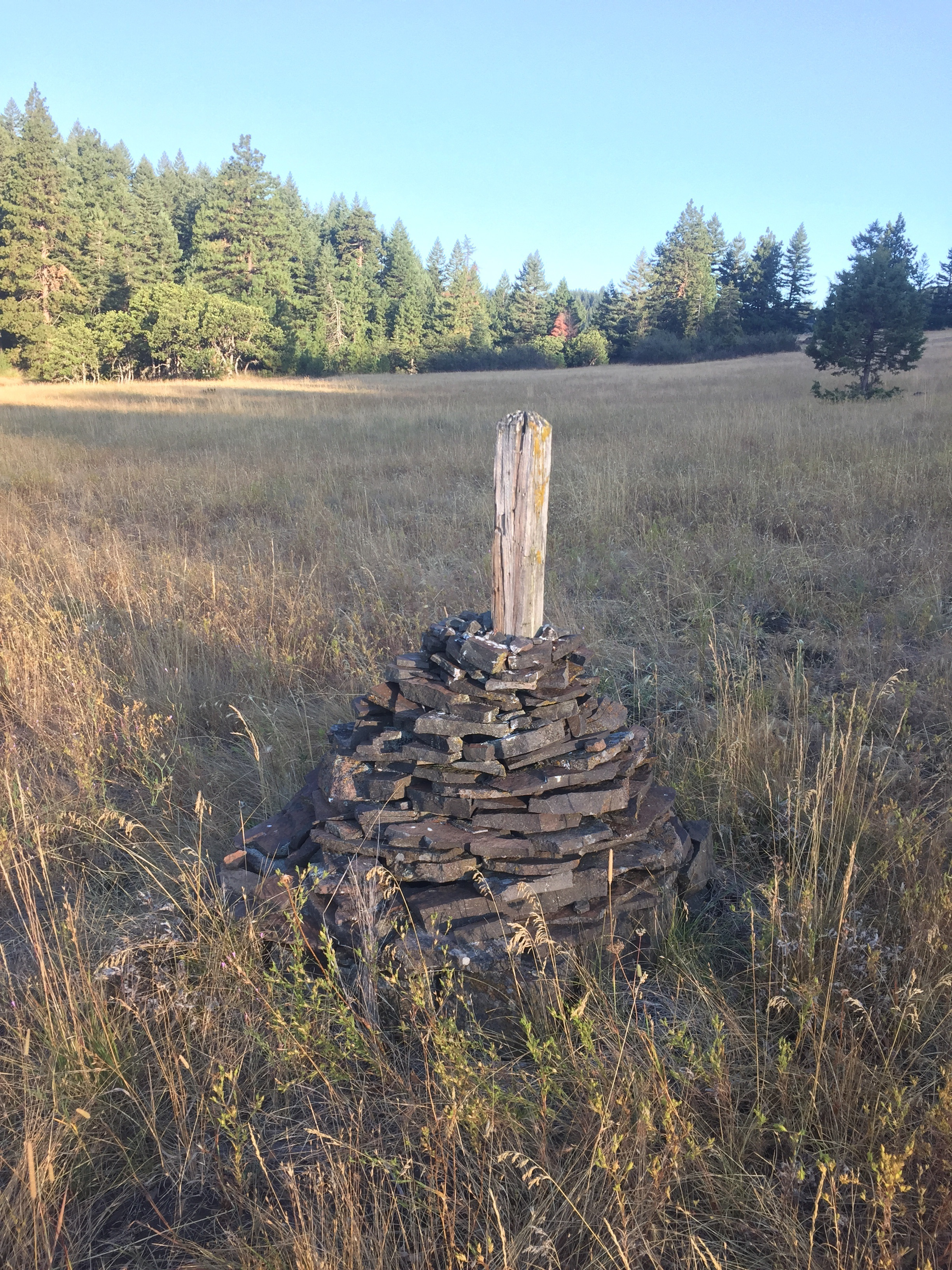 Big rock cairns mark the trail across the meadow below Hyatt Prairie
