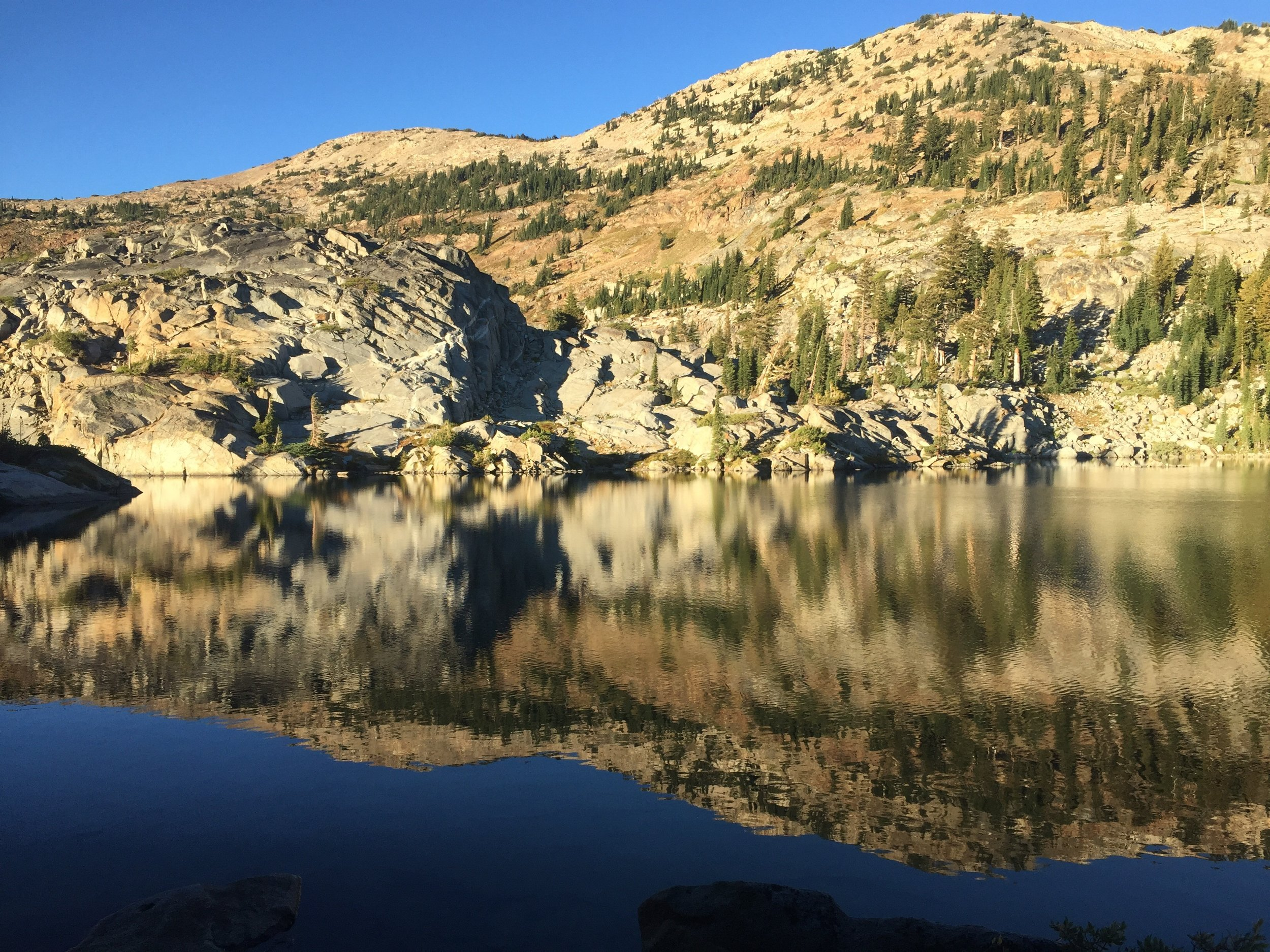 Morning light and reflection in Fontanillis Lake