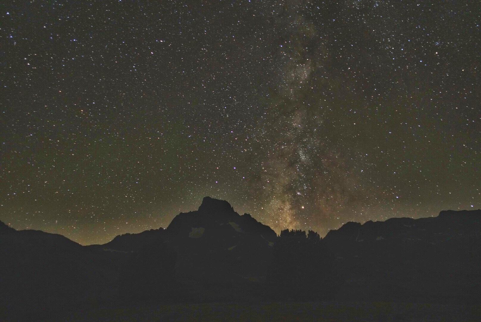 The Milky Way erupting like the Vegas strip above Banner Peak.