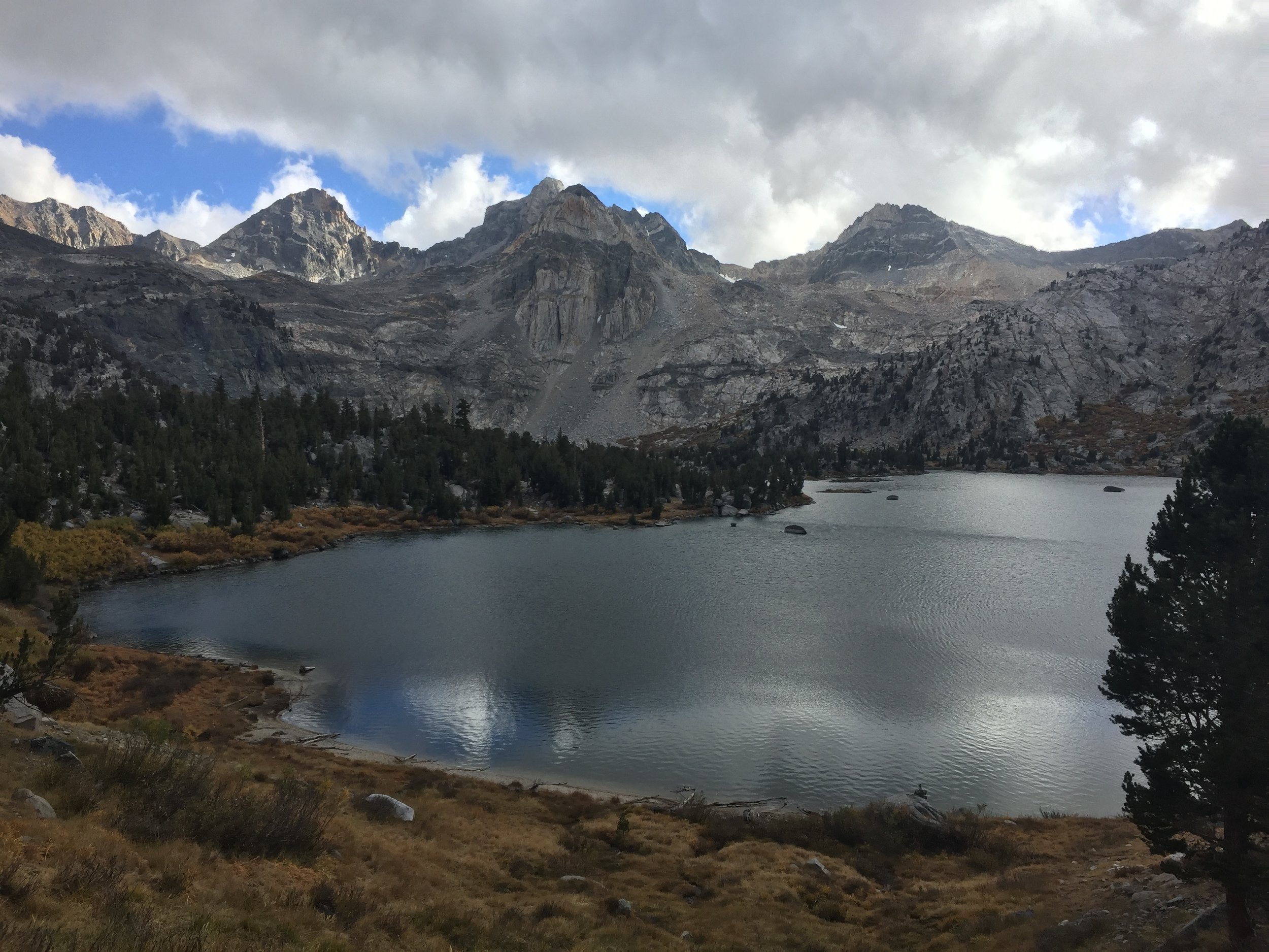 The forecast called for possible precipitation, and the sky has changed rapidly as we make our final approach to Rae Lakes on Day 89 so we'll hurry to pick a campsite in case those clouds mean business. Without the sun the temperature has dropped precipitously.