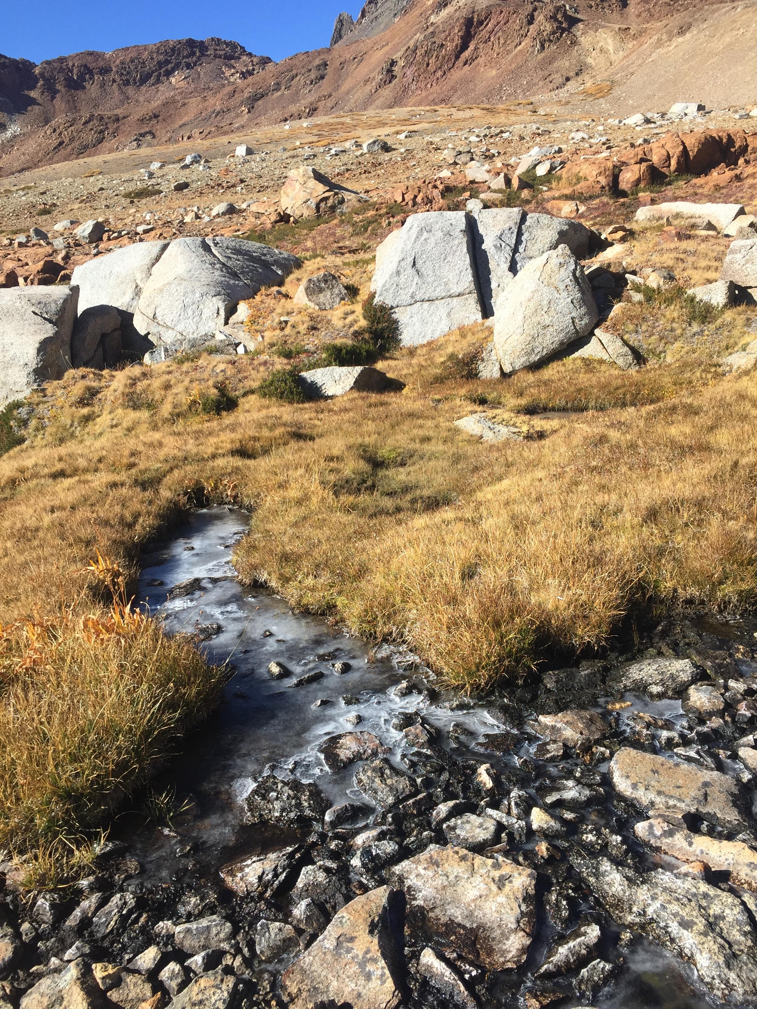 A frozen creek in full sun, in late morning