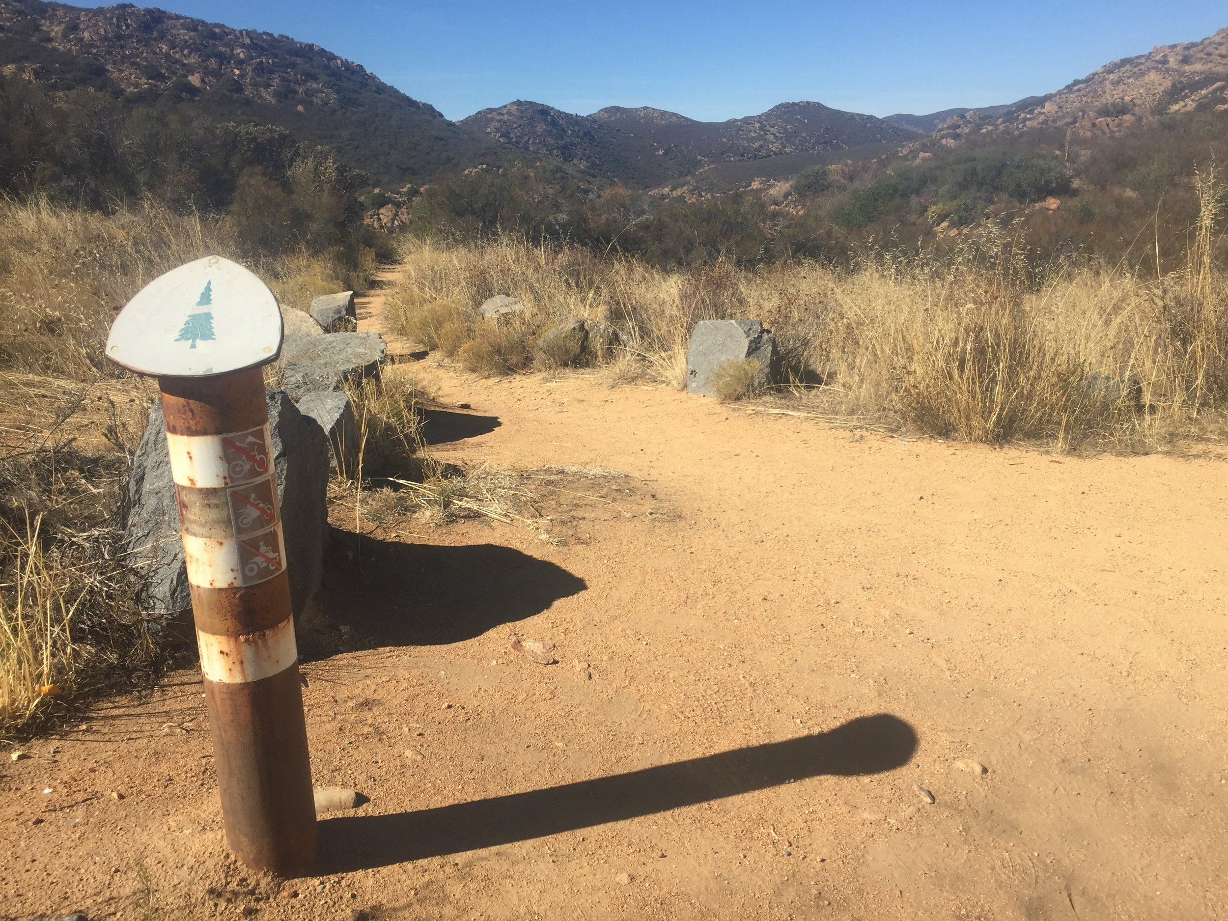 PCT trail marker at the Kitchen Creek Road crossing