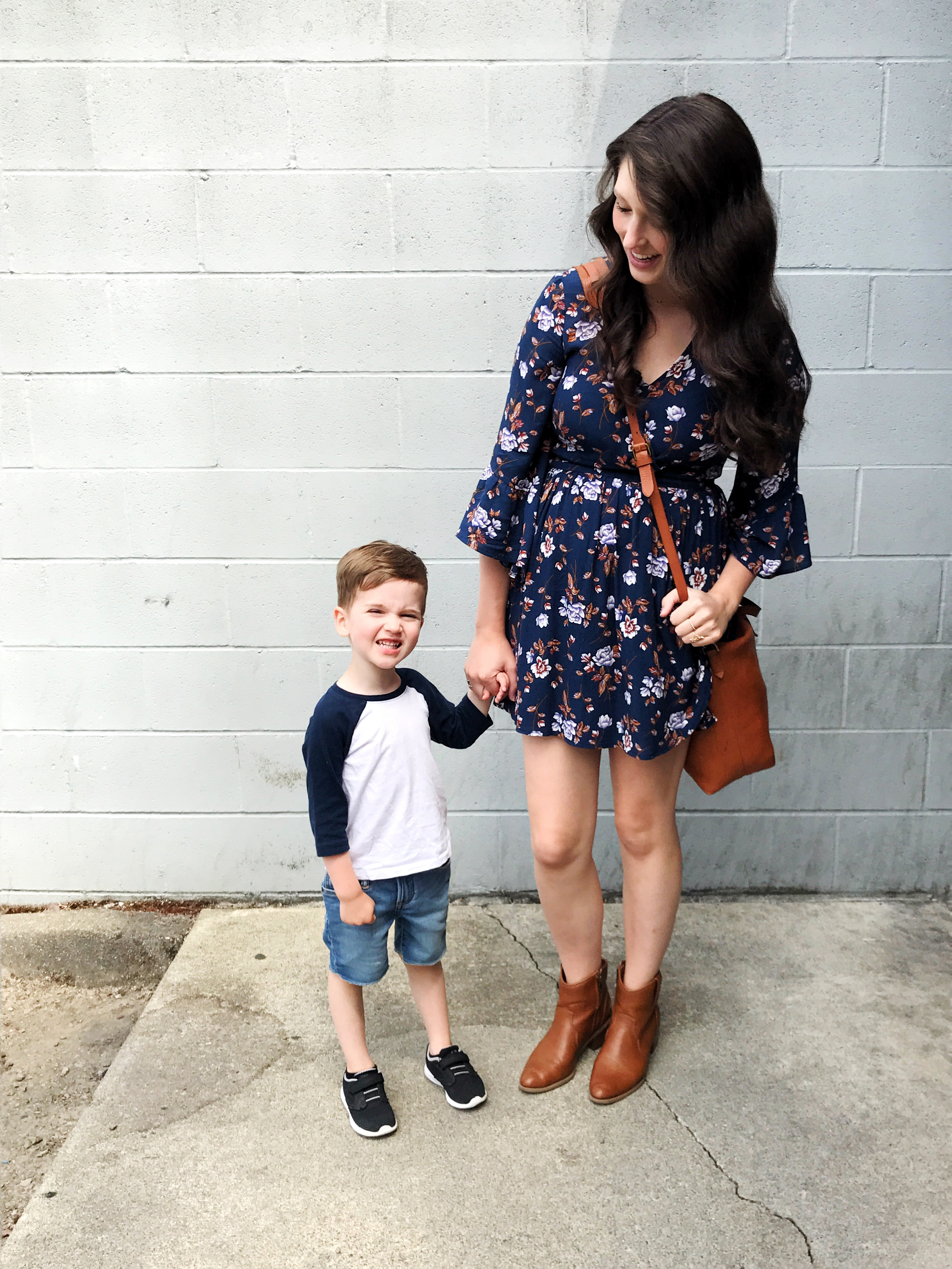 Leanna:  American Eagle Wrap Dress (similar)  //  American Eagle Booties (similar)  //  Madewell Tote   Connor: Old Navy Shirt // Gap Skinny Jeans //  Champion Athletic Shoes