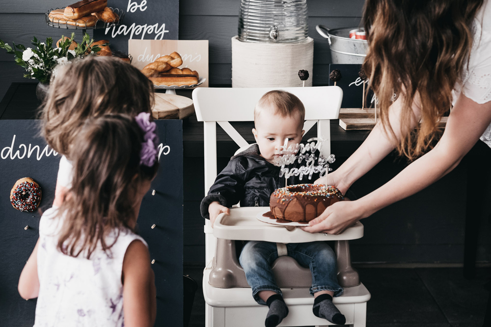 Donut party, doughnut party, first birthday party ideas, doughnut jokes, donut phrases, donut sign, doughnut sign, doughnut birthday ideas, donut birthday ideas, first birthday ideas, boys birthday party, 100 layer cake party, boys first birthday ideas, doughnut pegboard, donut pegboard, donut display wall, doughnut display wall, chic boys party, painted playhouse, white playhouse, playhouse makeover, outdoor play house makeover, donut cake, doughnut cake