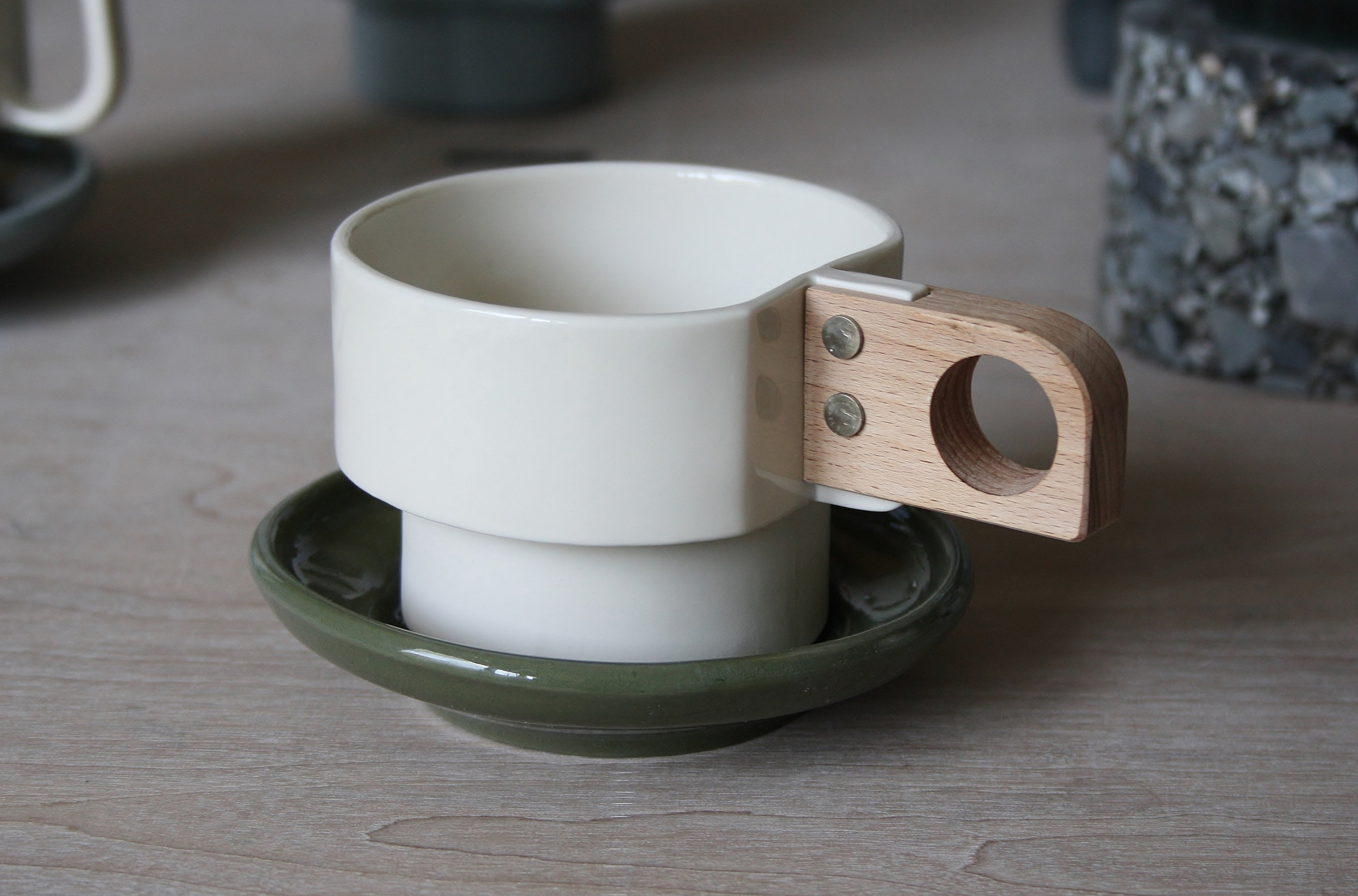 Atro-city Teacup and Moss Green Saucer by Emma Johnson