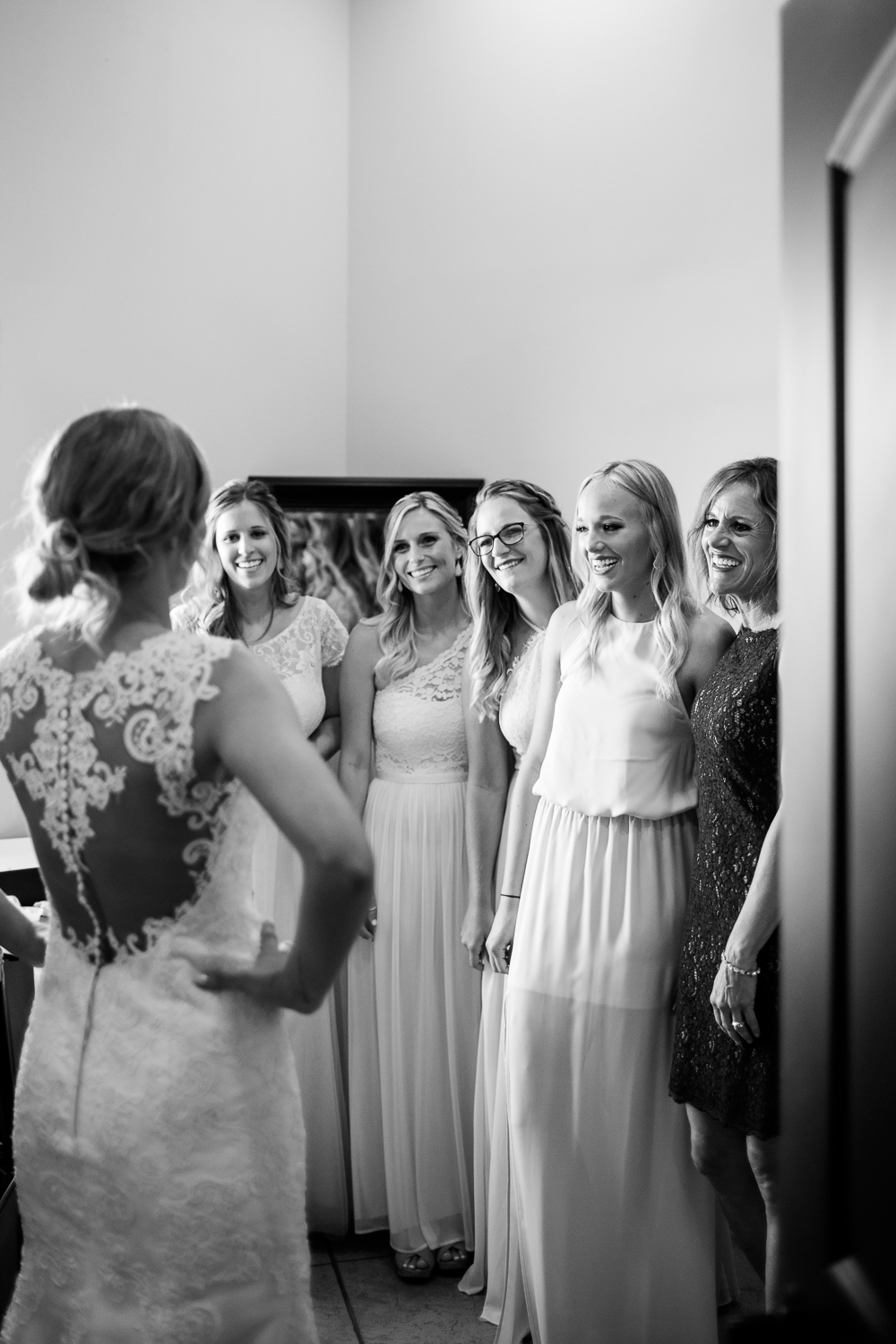 bride doing first look with her bridesmaids